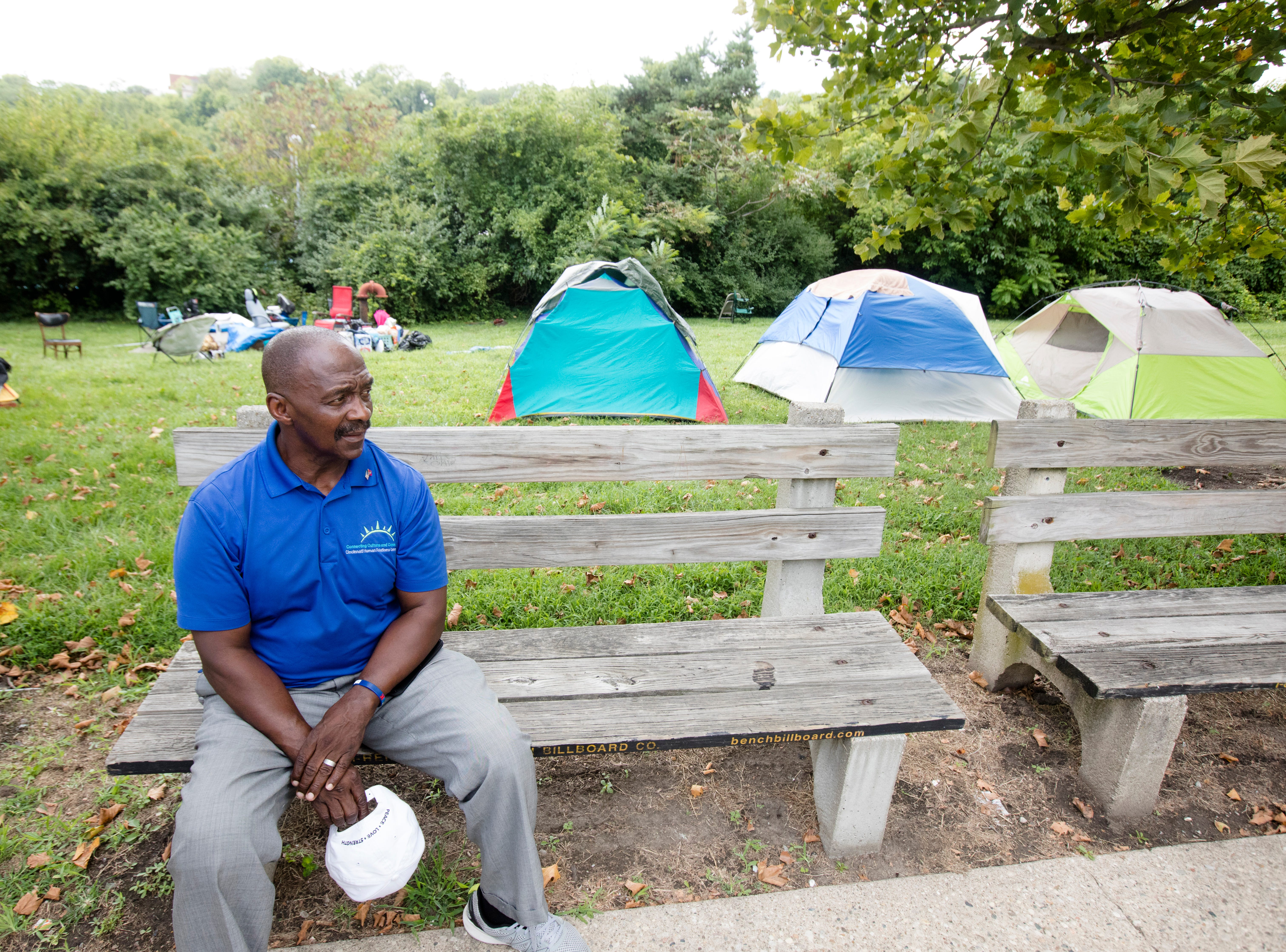 Rev/. Peterson Mingo sits outside of a homeless encampment on the 1700 block of Gilbert Avenue in Walnut Hills.