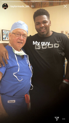 Bengals guard Rod Taylor poses with his doctor as he has surgery on his torn ACL.