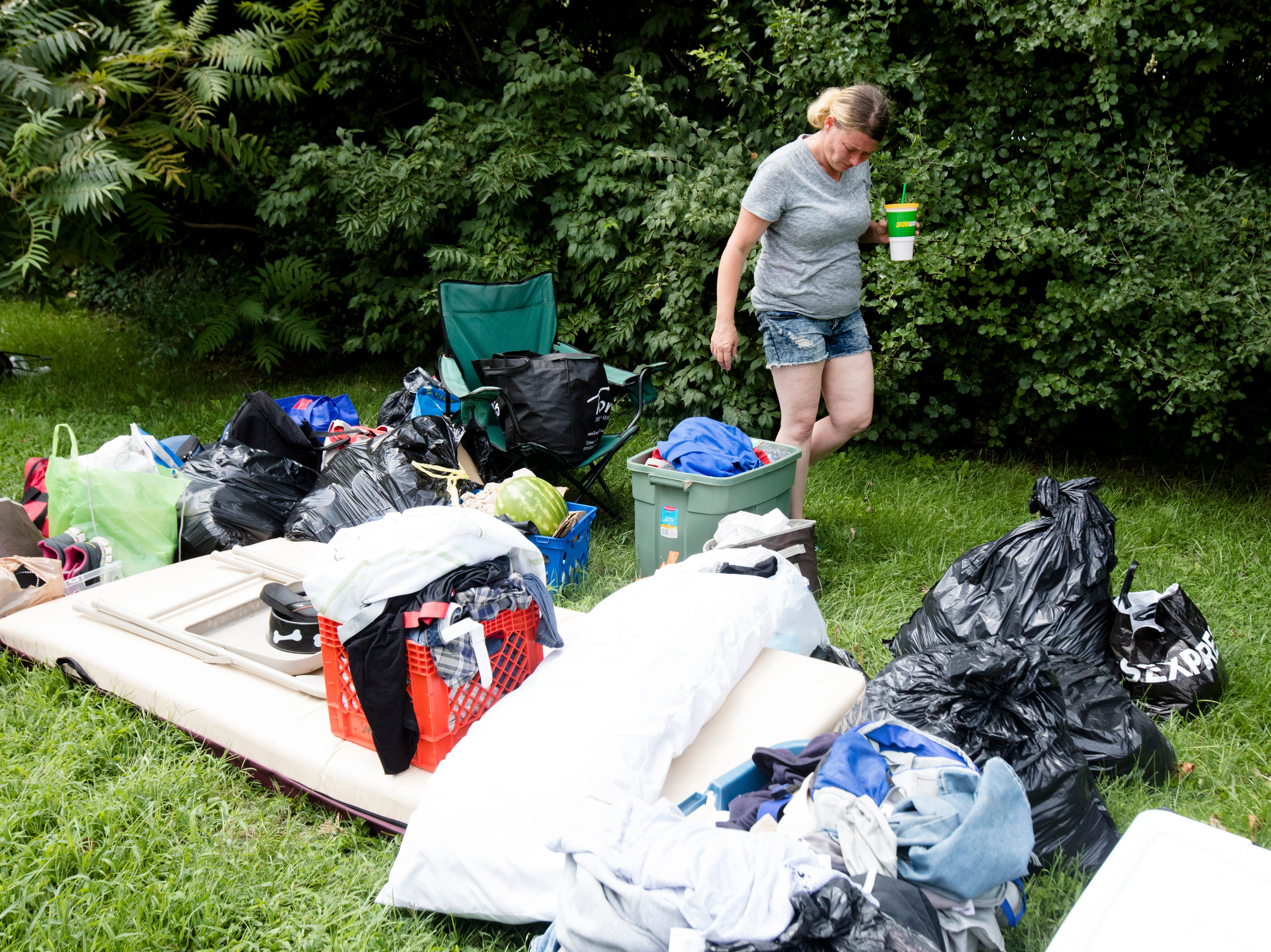 Miranda Horsley packs her things to move out of a homeless encampment on the 1700 block of Gilbert Avenue in Walnut Hills.