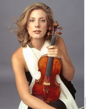 Elizabeth Pitcairn headshot with the Red Violin