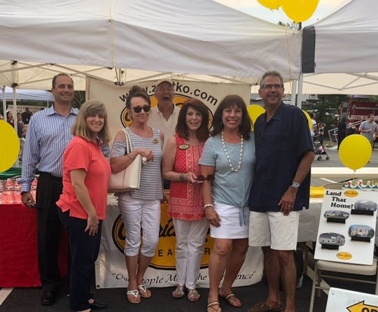 Gloria Zastko, Realtors agents had a booth at the 2018 North Brunswick National Night Out to give away prizes, run a game for children and answer questions about the real estate market.