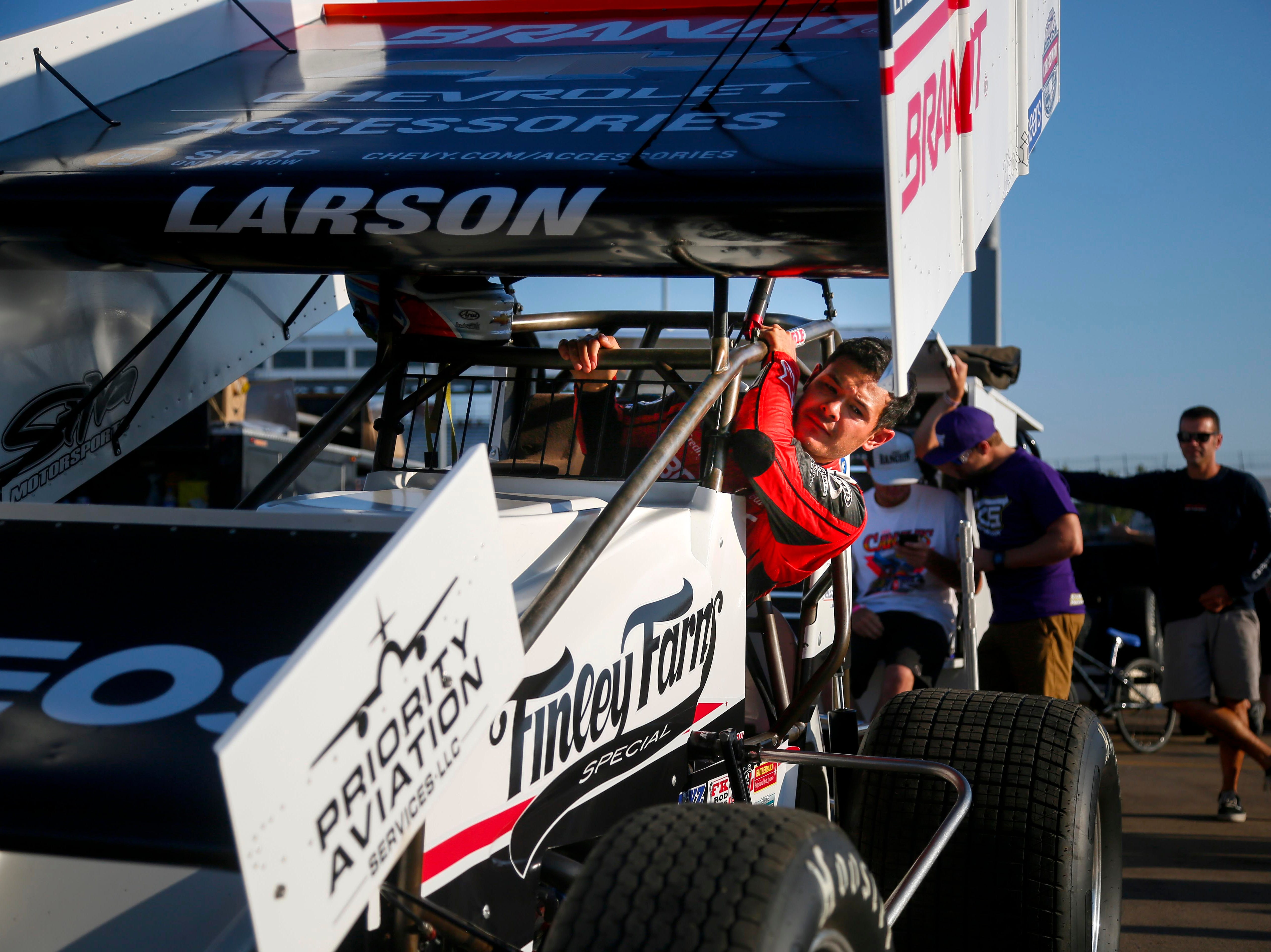 Kyle Larson climbs into his car during the Knoxville Nationals Wednesday, Aug. 8, 2018.