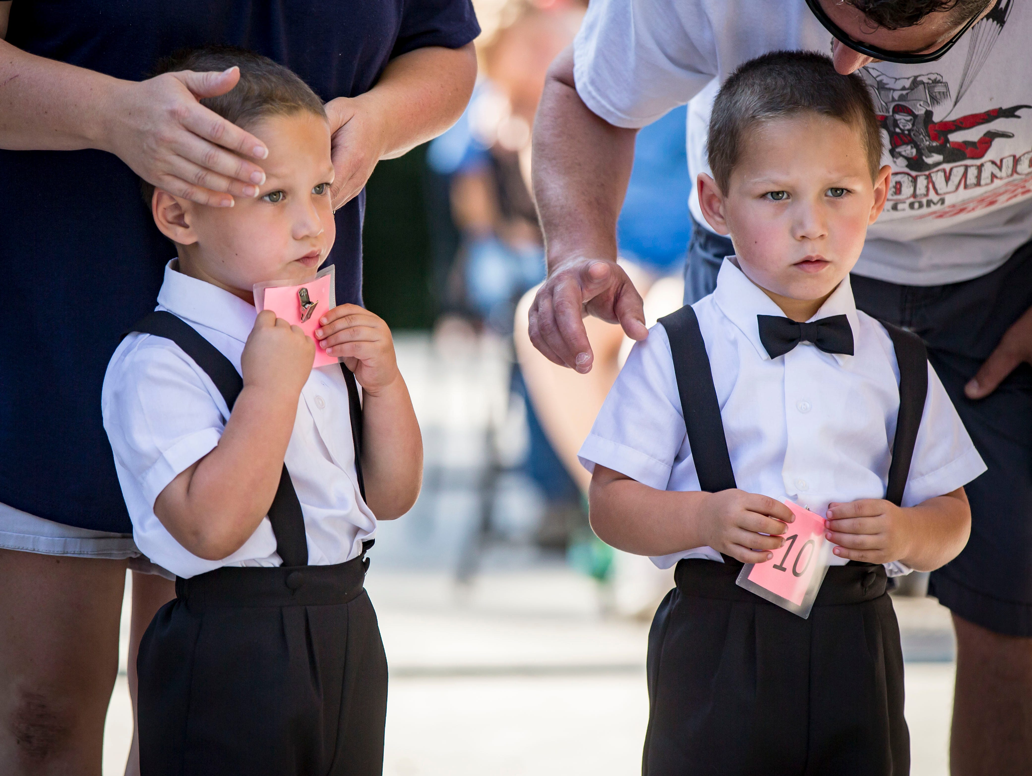 Sagan, left, and John Lack of Windsor Heights compete in the three-year-old most alike category during the Twins, Triplets and More Contest on the Anne and Bill Riley Stage at the 2018 Iowa State Fair in Des Moines Thursday, Aug. 9, 2018.