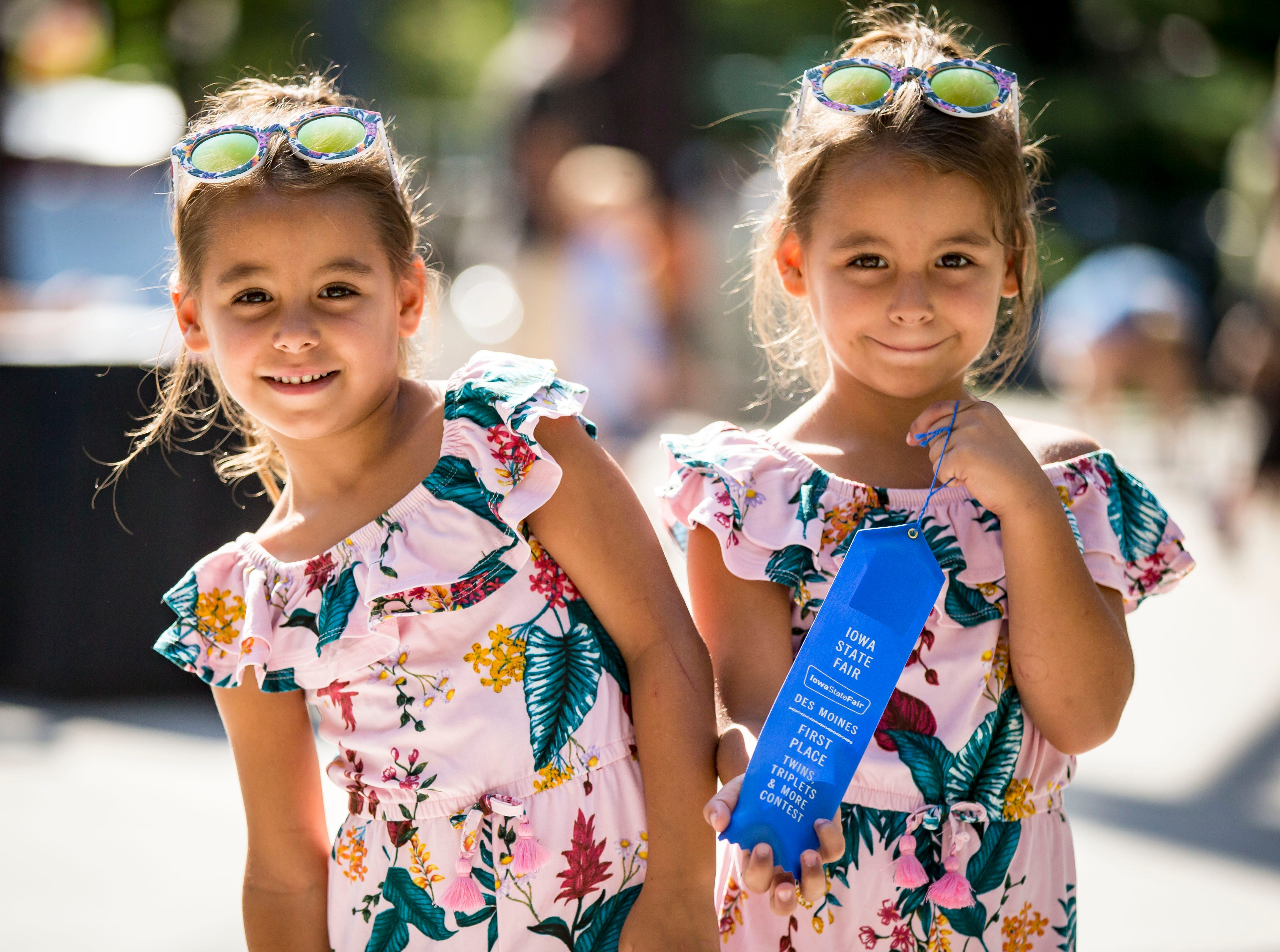 Blue ribbon winners in the five and six year old category Rory, left, and Nellie Deutmeyer of Urbandale during the Twins, Triplets and More Contest on the Anne and Bill Riley Stage at the 2018 Iowa State Fair in Des Moines Thursday, Aug. 9, 2018.