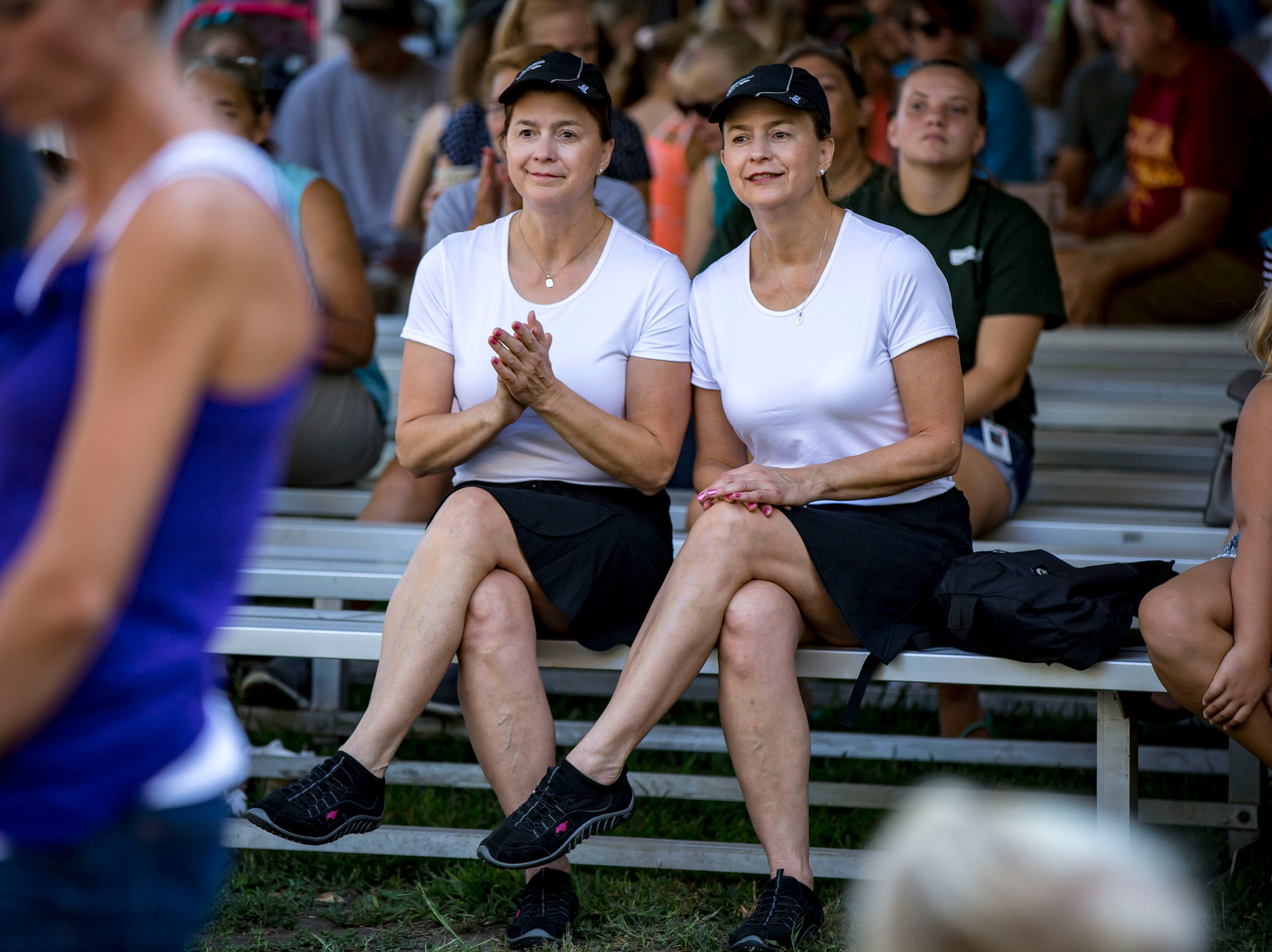 Karma Nielsen of Altoona, left and her sister Larla Alexander of Phoenix, Arizona, wait to compete during the Twins, Triplets and More Contest on the Anne and Bill Riley Stage at the 2018 Iowa State Fair in Des Moines Thursday, Aug. 9, 2018.