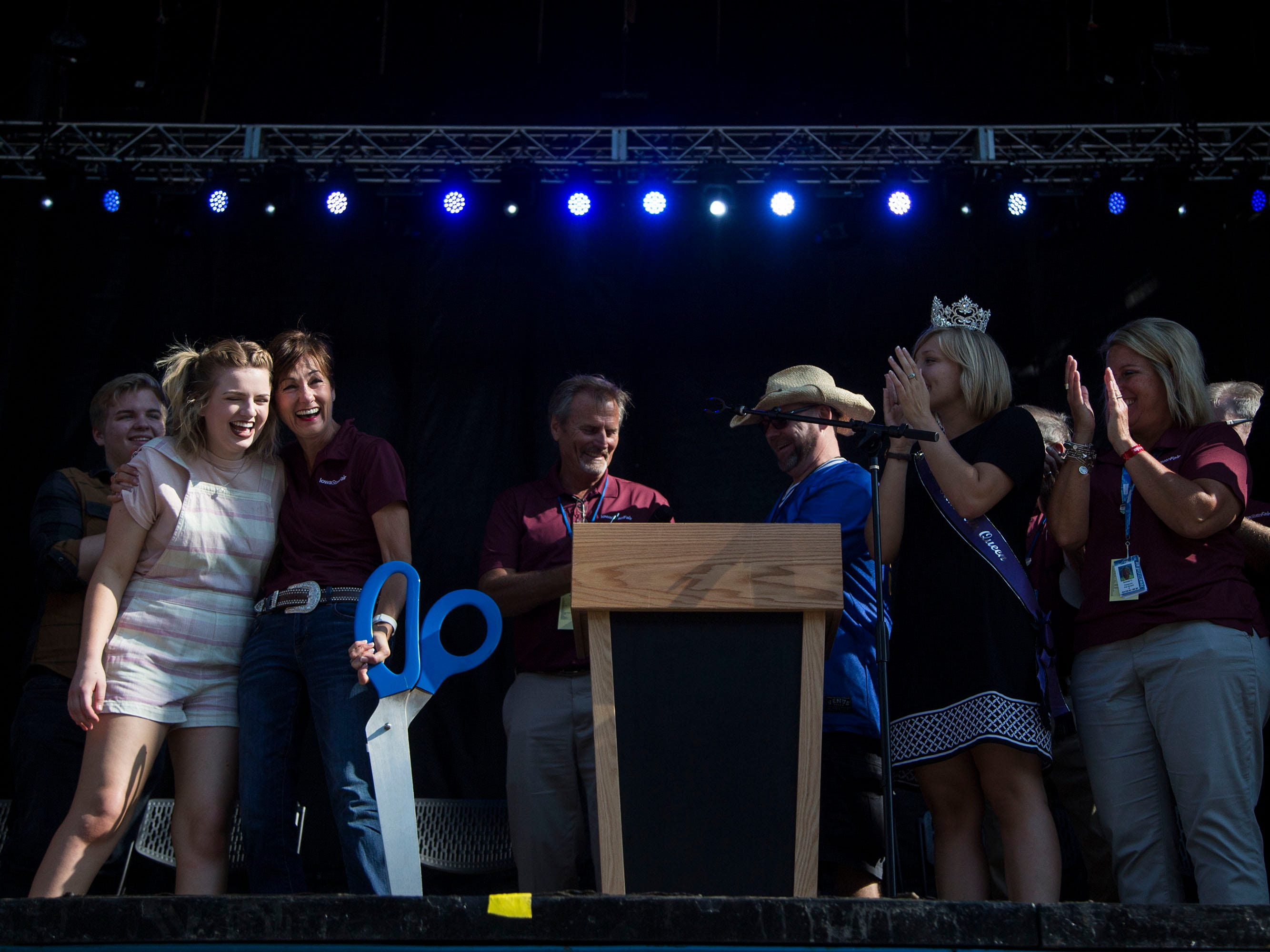 Iowa Governor Kim Reynolds and Maddie Poppe, winner of season 16 of American Idol and Iowa native, cut the ribbon of the updated Iowa State Fair grandstand during the opening ceremony for the state fair on Thursday, August 9, 2018, in Des Moines.