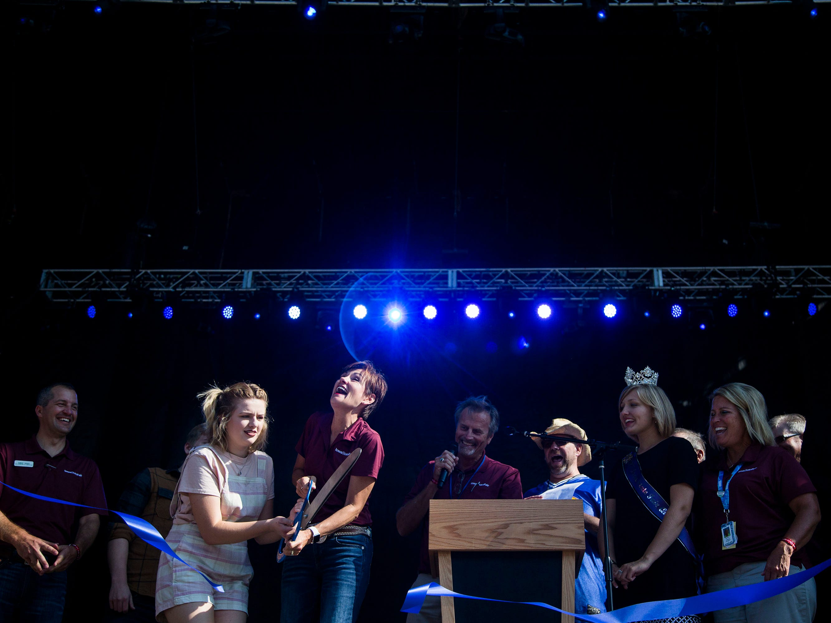 Iowa Governor Kim Reynolds and Maddie Poppe, winner of season 16 of American Idol and Iowa native, cut the ribbon of the updated Iowa State Fair grandstand during the opening ceremonies for the state fair on Thursday, August 9, 2018, in Des Moines.