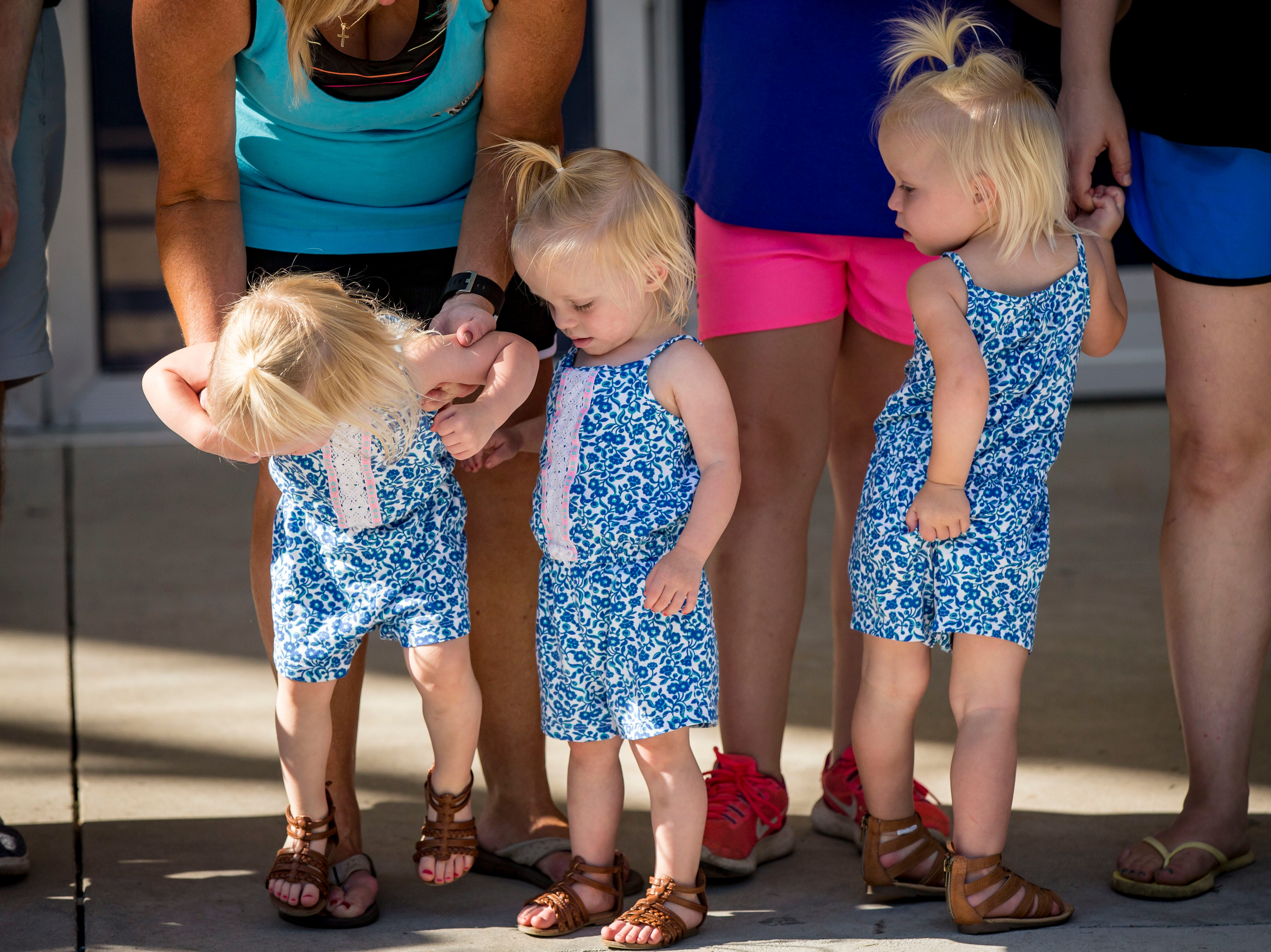 Charlotte, left, Nora and Hazel Hanssan of Grinnell compete in the two-year-old most alike category during the Twins, Triplets and More Contest on the Anne and Bill Riley Stage at the 2018 Iowa State Fair in Des Moines Thursday, Aug. 9, 2018.
