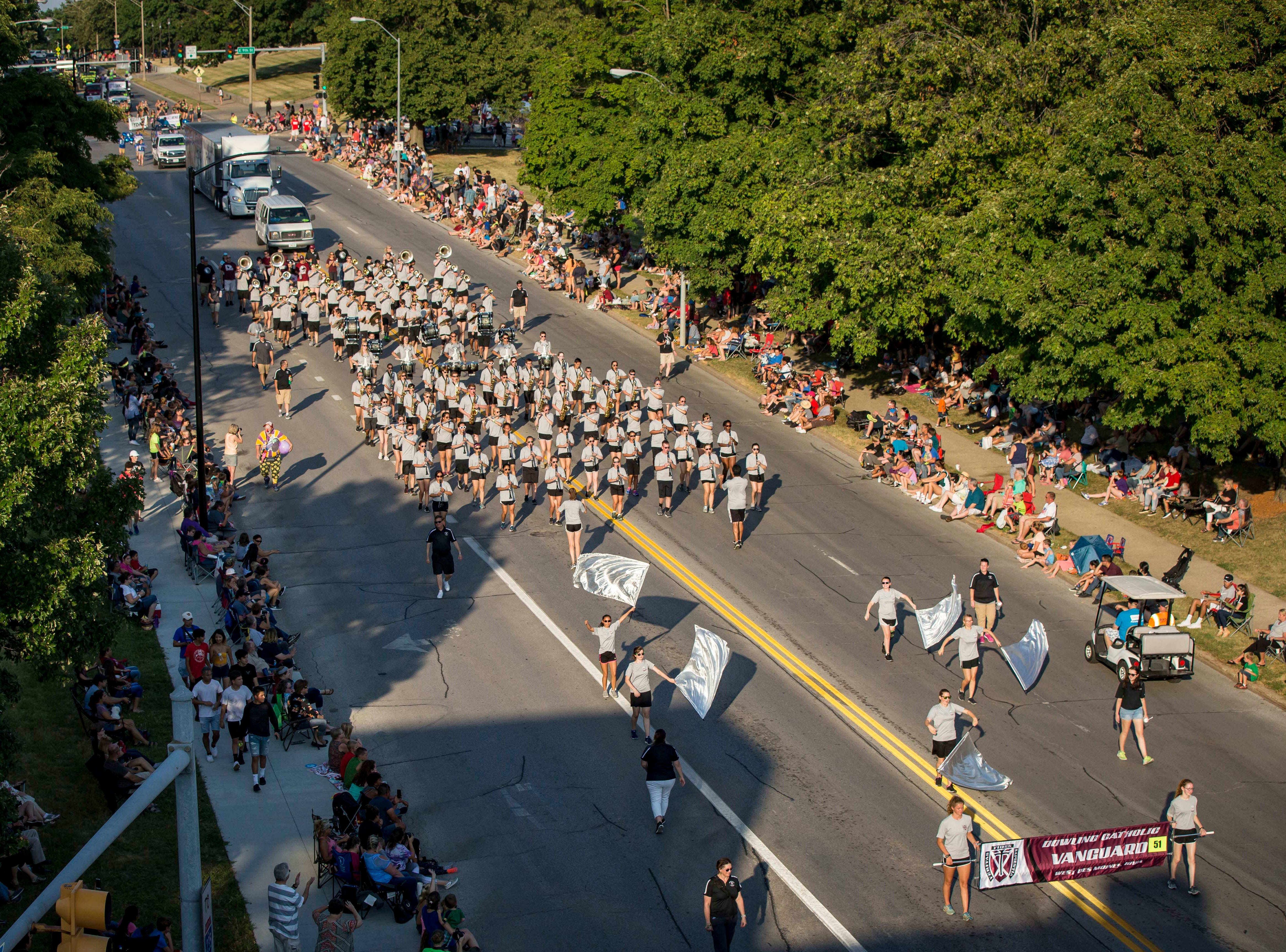 Dowling Catholic Vanguard marching band moves along the 2018 Iowa State Fair parade from the Statehouse to downtown Des Moines Wednesday, Aug. 8, 2018. The Iowa State Fair runs from Aug. 9Ð19.