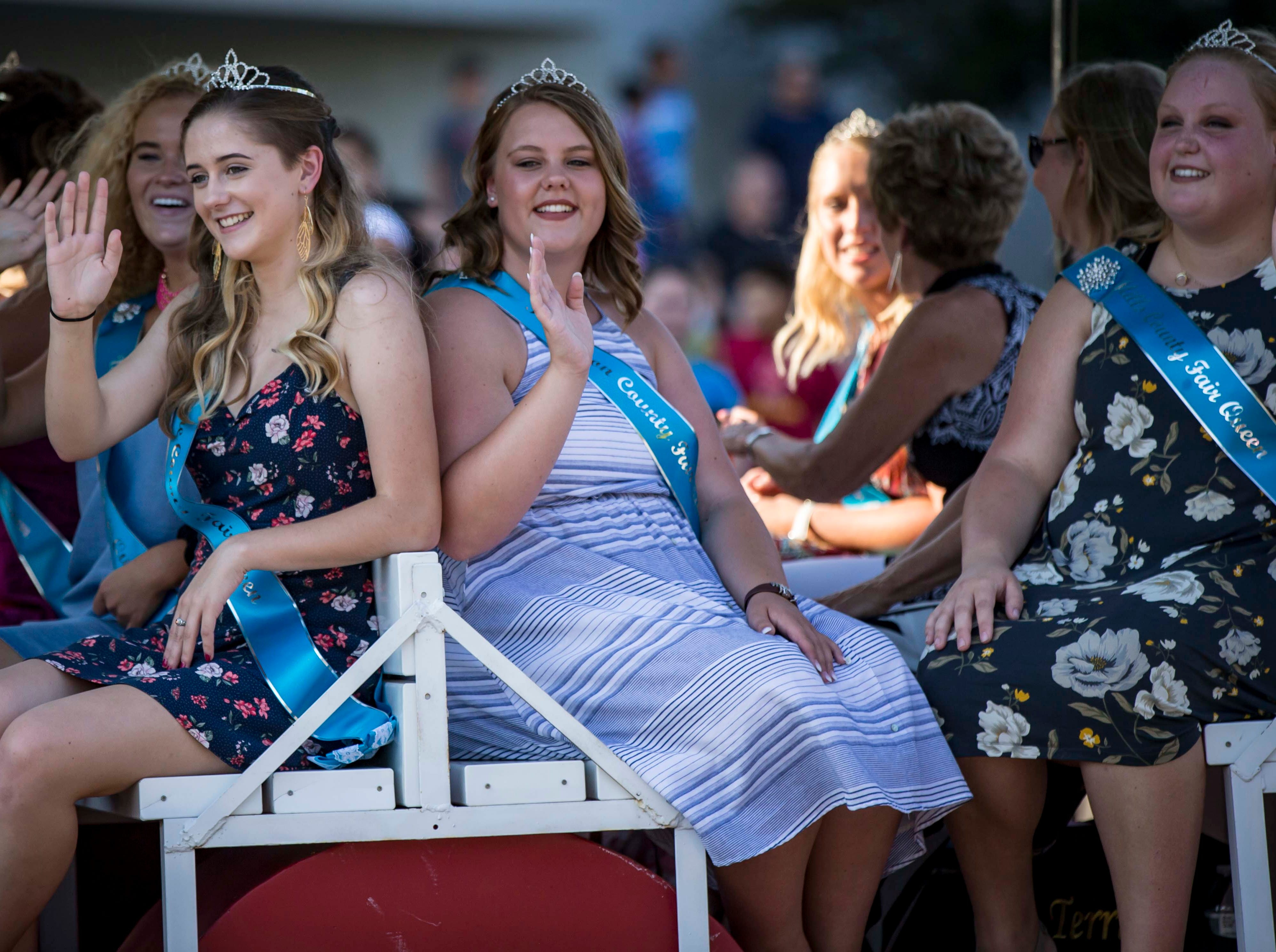 Iowa State Fair queen candidates from around the state ride in the 2018 Iowa State Fair parade from the Statehouse to downtown Des Moines Wednesday, Aug. 8, 2018. The Iowa State Fair runs from Aug. 9Ð19.