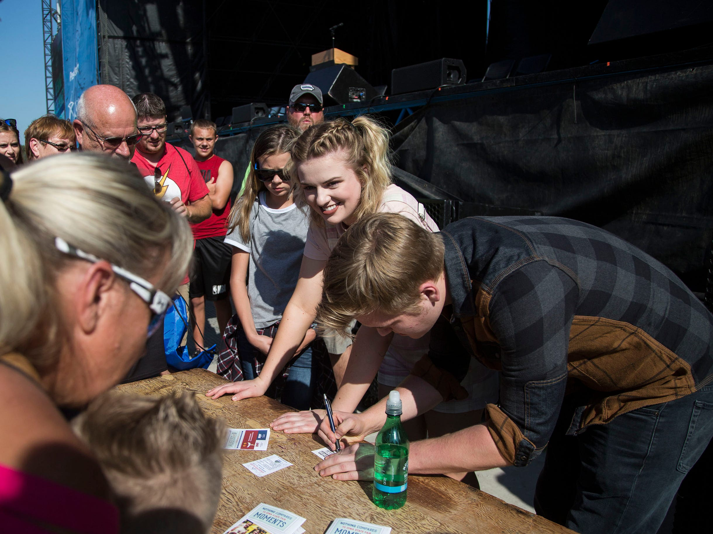 Maddie Poppe, winner of season 16 of American Idol and Iowa native, signs autographs after attending the opening ceremonies for the Iowa State Fair on Thursday, August 9, 2018, in Des Moines.