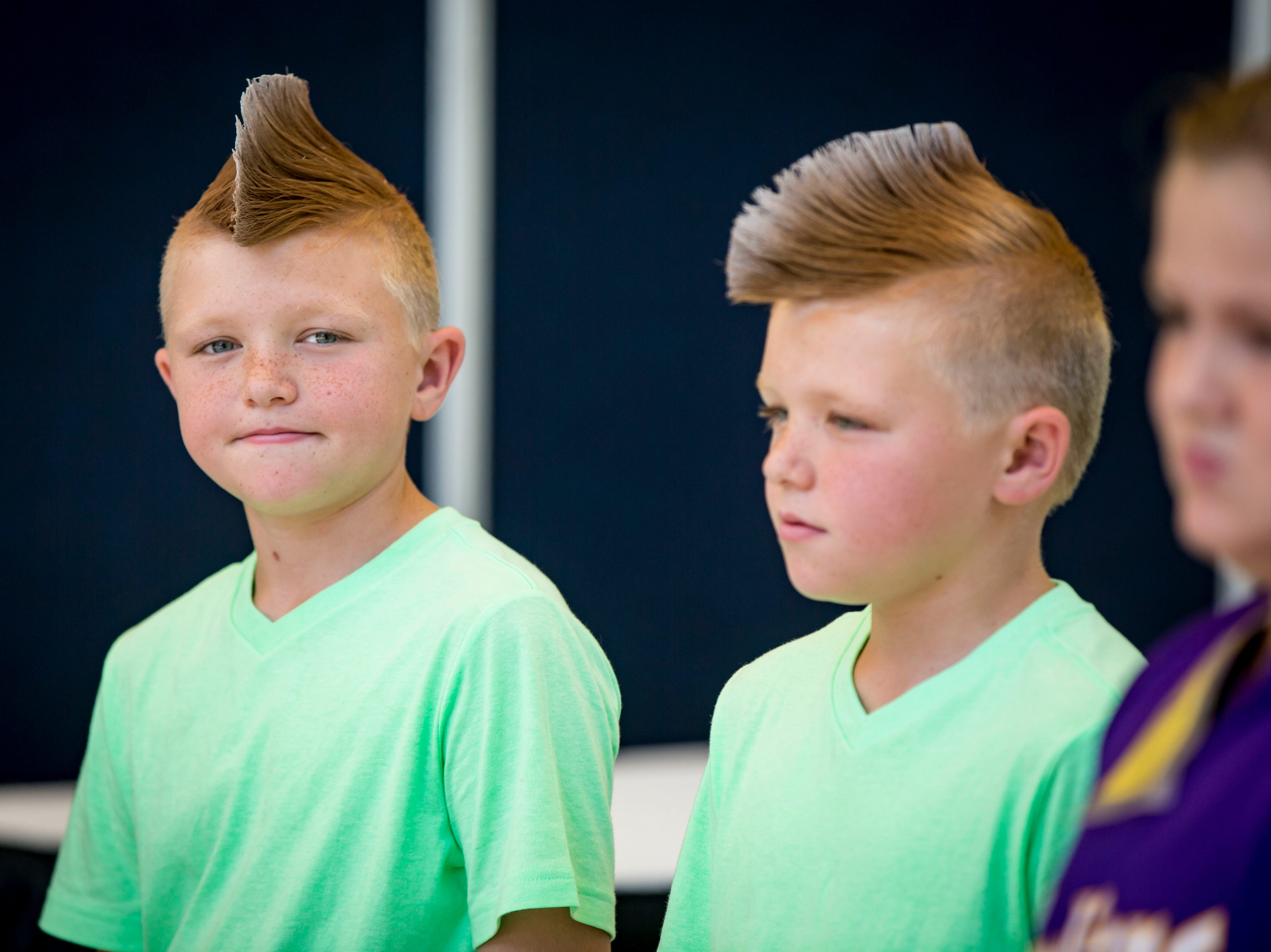 Dax, left, and Colby Putz of Otley during the Twins, Triplets and More Contest on the Anne and Bill Riley Stage at the 2018 Iowa State Fair in Des Moines Thursday, Aug. 9, 2018.