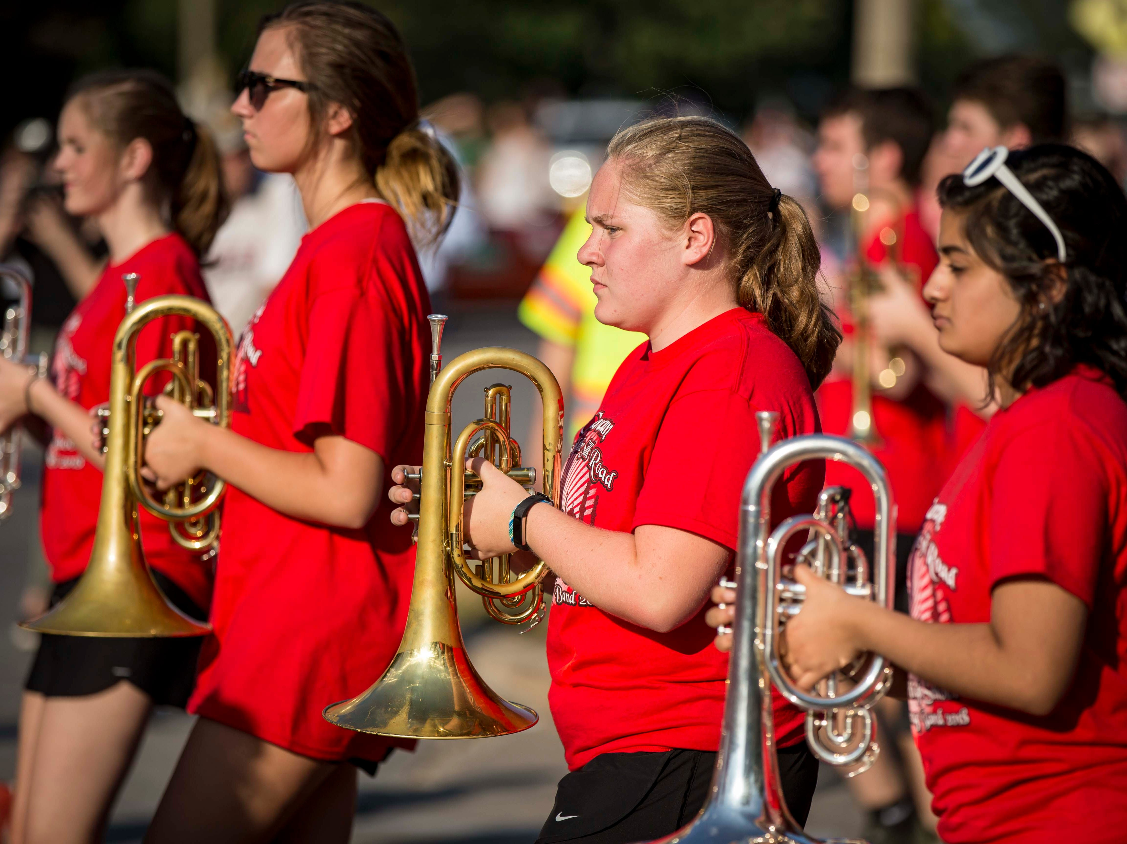 Members of the Cedar Falls High School Tiger Marching Band march during the 2018 Iowa State Fair parade from the Statehouse to downtown Des Moines Wednesday, Aug. 8, 2018. The Iowa State Fair runs from Aug. 9Ð19.