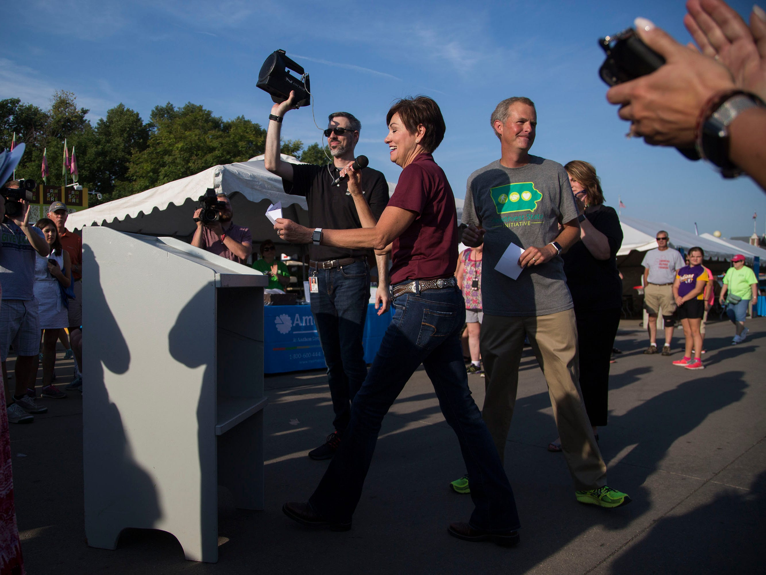 Iowa Governor Kim Reynolds kicks off the first day of the Iowa State Fair with remarks at the start of the historic walking tour on Thursday, Aug. 9, 2018, in Des Moines.