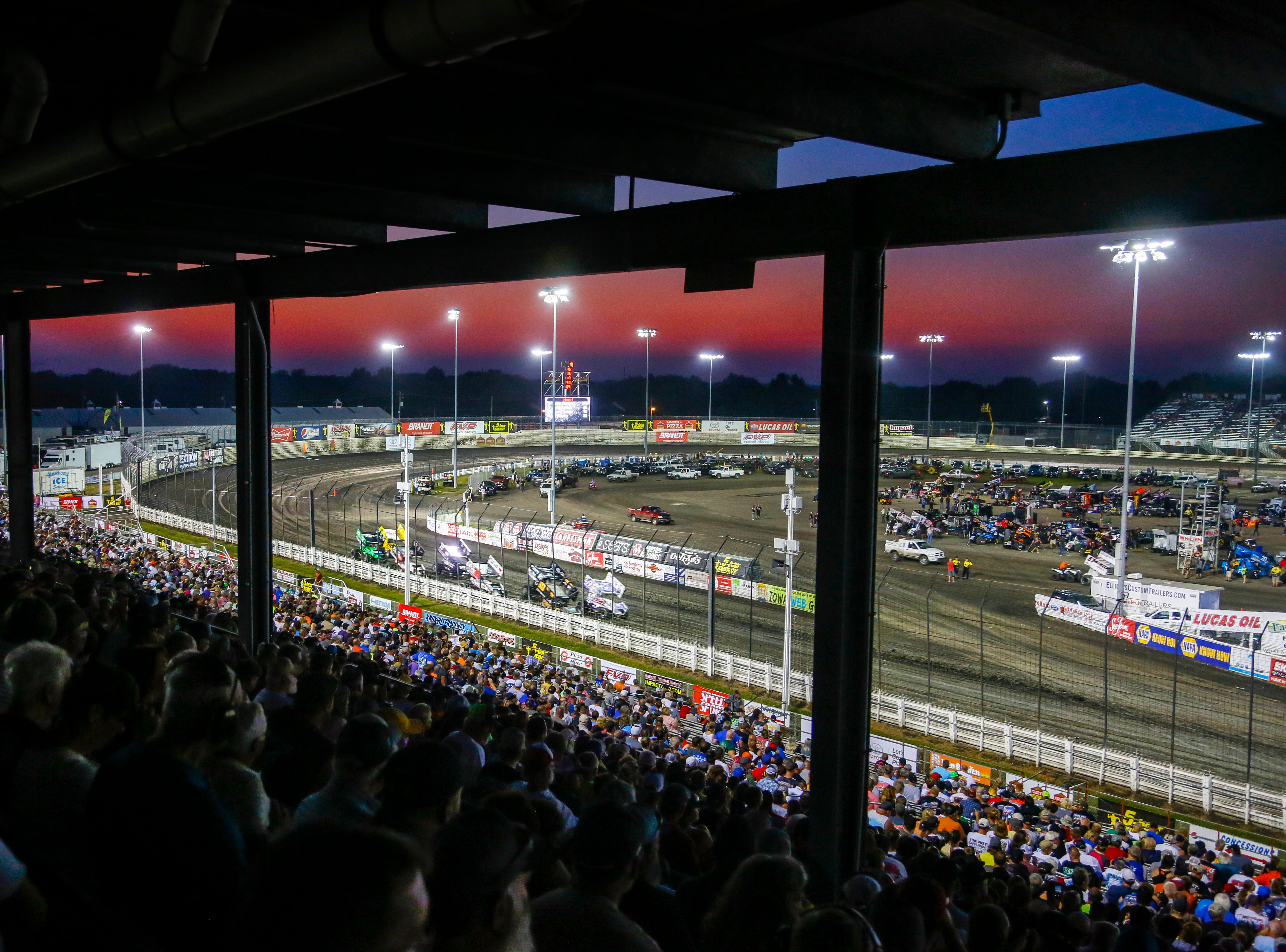 Cars round the track during the Knoxville Nationals Wednesday, Aug. 8, 2018.