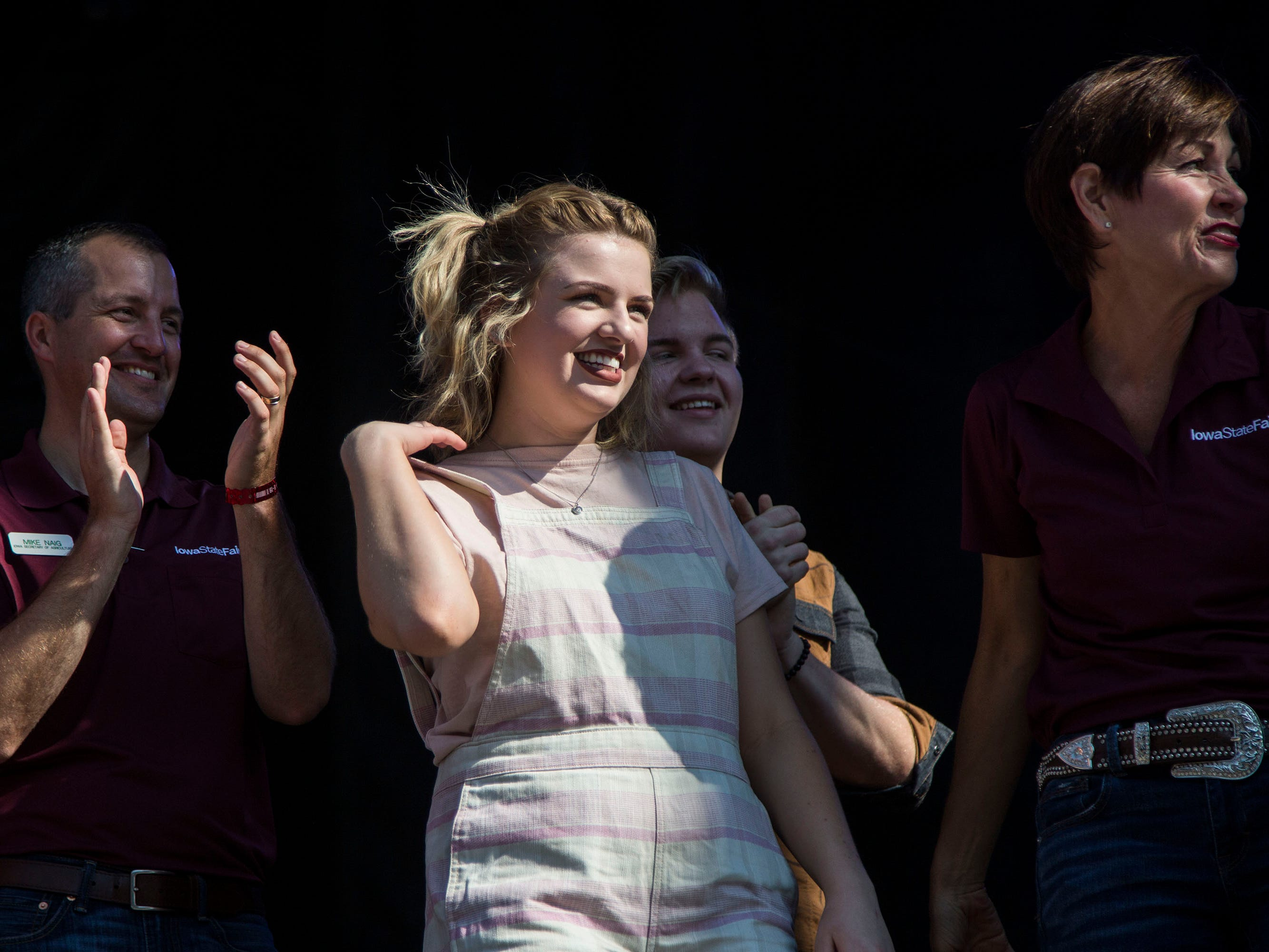 Maddie Poppe, winner of season 16 of American Idol and Iowa native, stands on stage with Iowa Governor Kim Reynolds during the opening ceremonies for the Iowa State Fair on Thursday, August 9, 2018, in Des Moines.