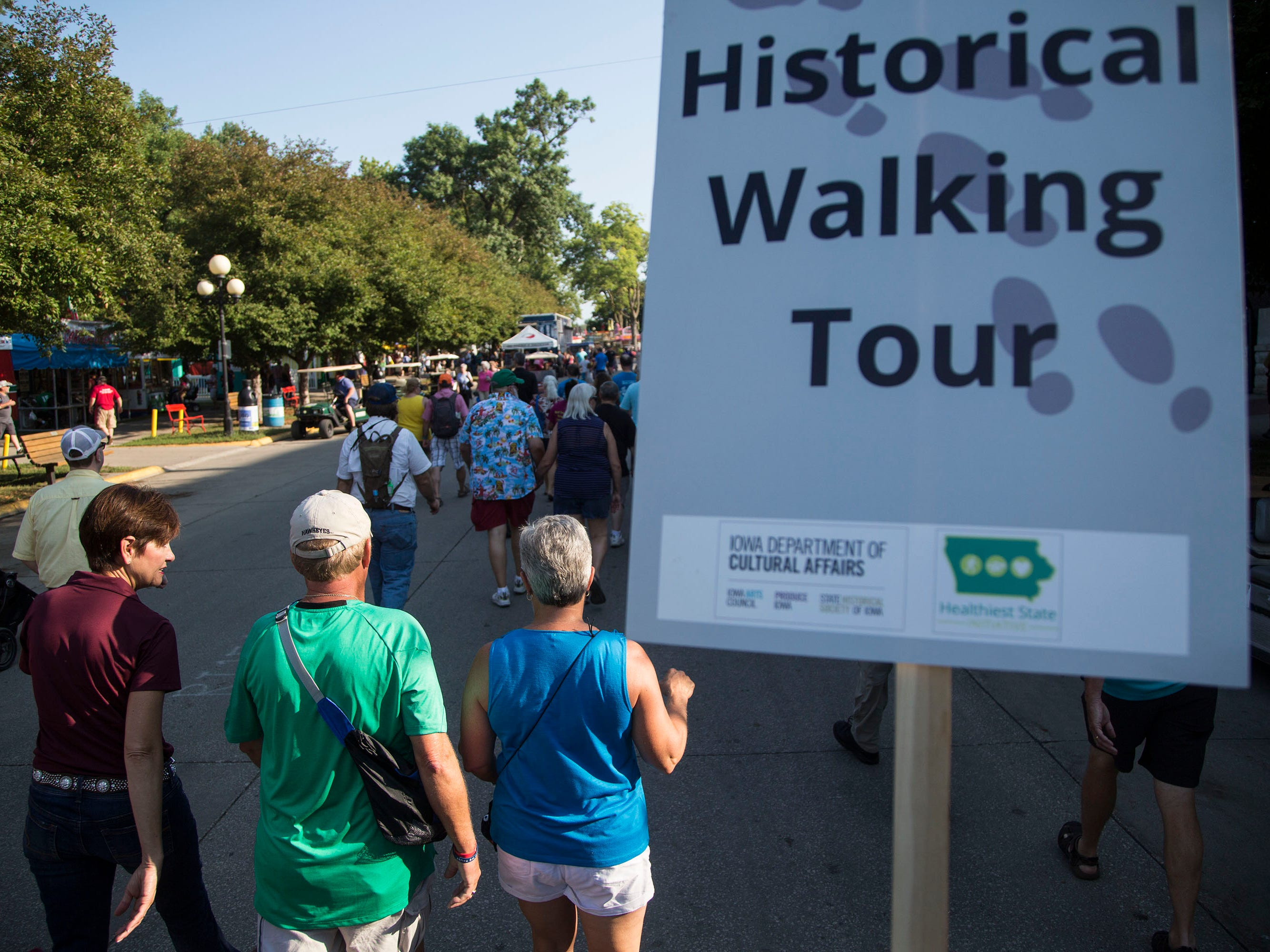 Iowa Governor Kim Reynolds talks with fairgoers on the Iowa State Fair historic walking tour on Thursday, Aug. 9, 2018, in Des Moines.