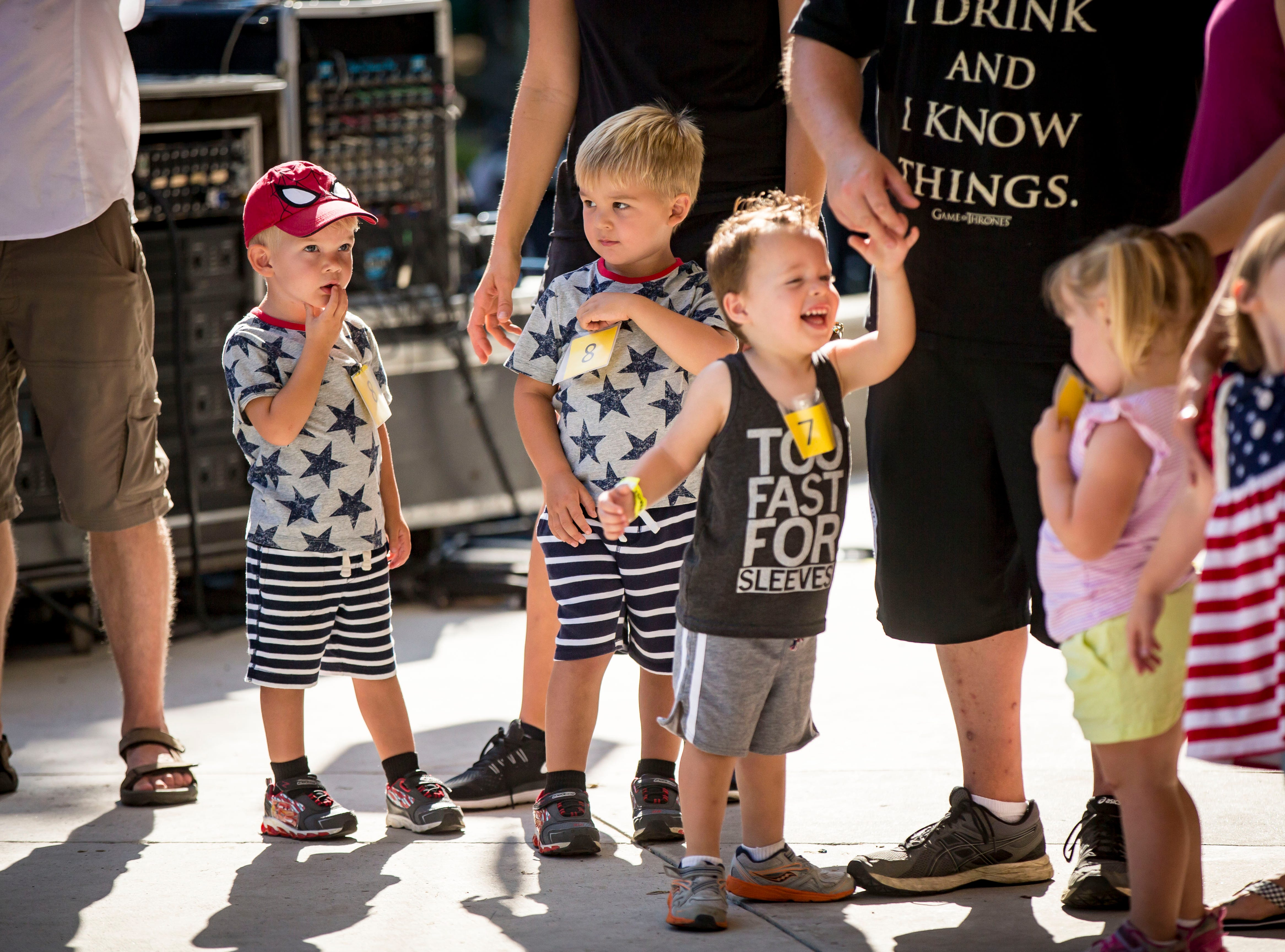 Competitors during the Twins, Triplets and More Contest on the Anne and Bill Riley Stage at the 2018 Iowa State Fair in Des Moines Thursday, Aug. 9, 2018.