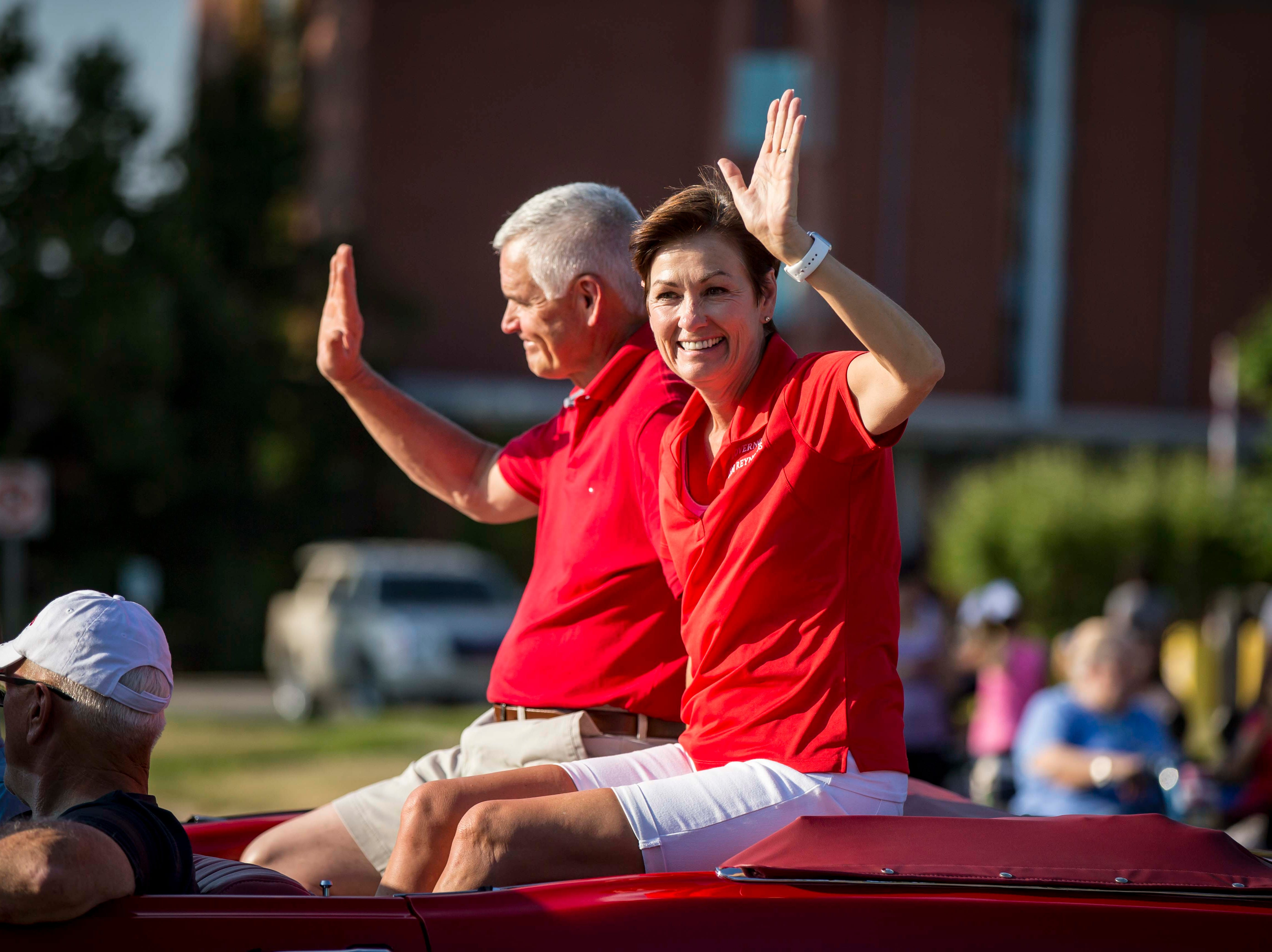 Iowa Gov. Kim Reynolds and her husband Kevin ride in the 2018 Iowa State Fair parade from the Statehouse to downtown Des Moines Wednesday, Aug. 8, 2018. The Iowa State Fair runs from Aug. 9Ð19.