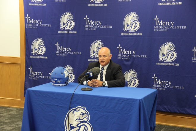 Drake coach Rick Fox speaks with the reporters at the school's football Media Day on Thursday.