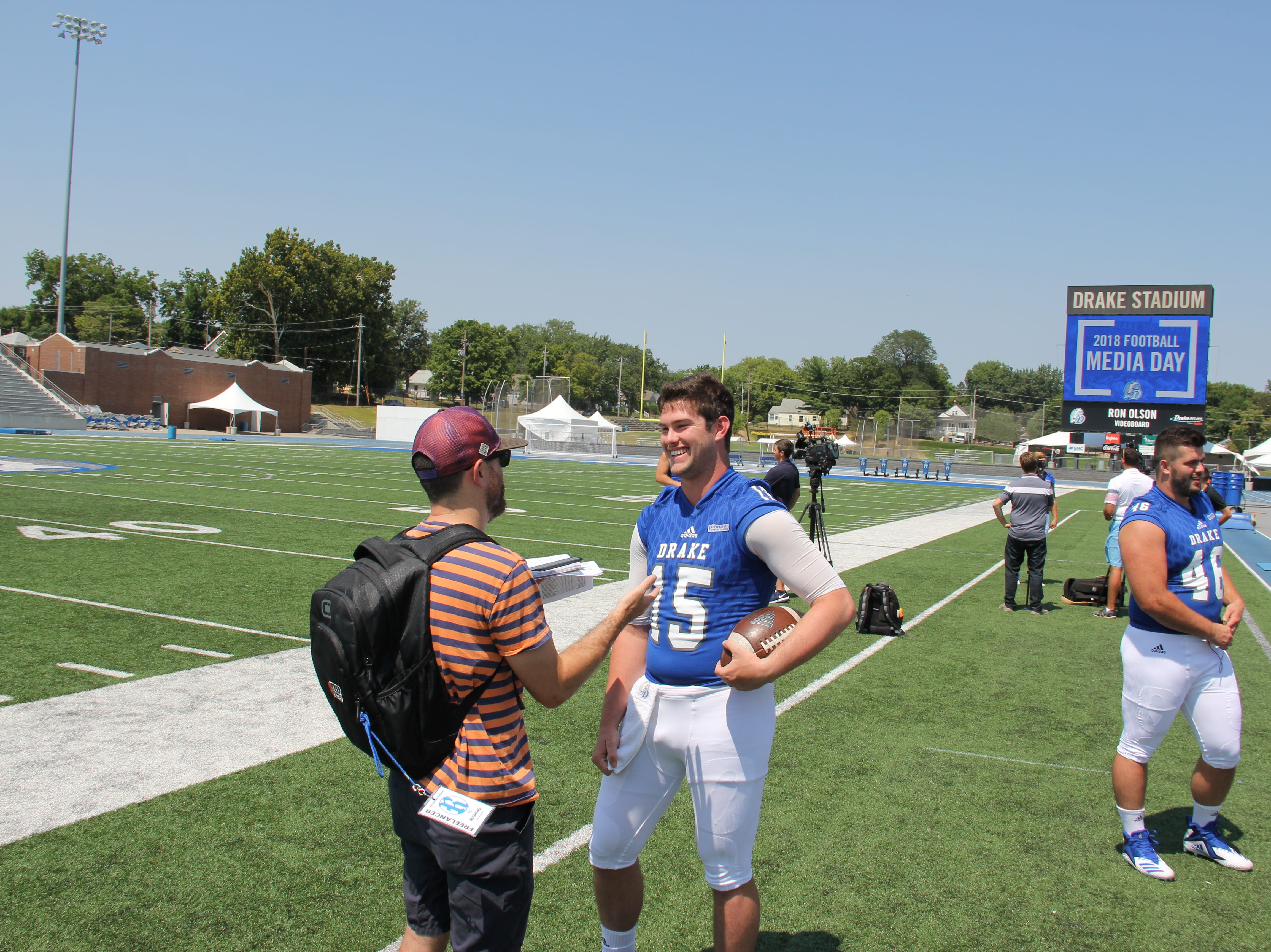 Starting quarterback Grant Kraemer, right, returns for his senior season at Drake after throwing for 20 touchdowns in 2017.