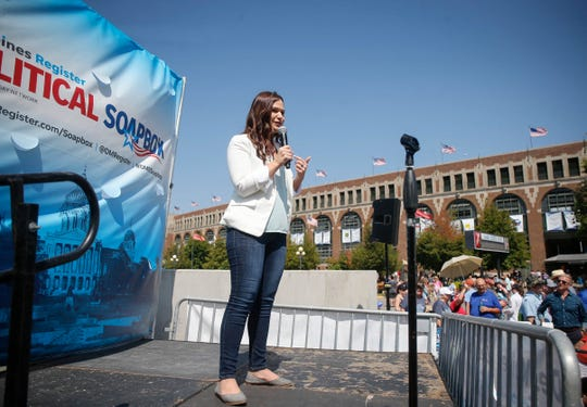 Abby Finkenauer, a democrat running for Iowa's First Congressional District, speaks to supporters at the Des Moines Register Political Soapbox during the Iowa State Fair in Des Moine.
