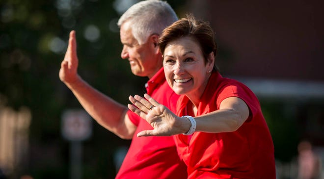 Iowa Gov. Kim Reynolds and her husband Kevin ride in the Iowa State Fair parade on Aug. 8.