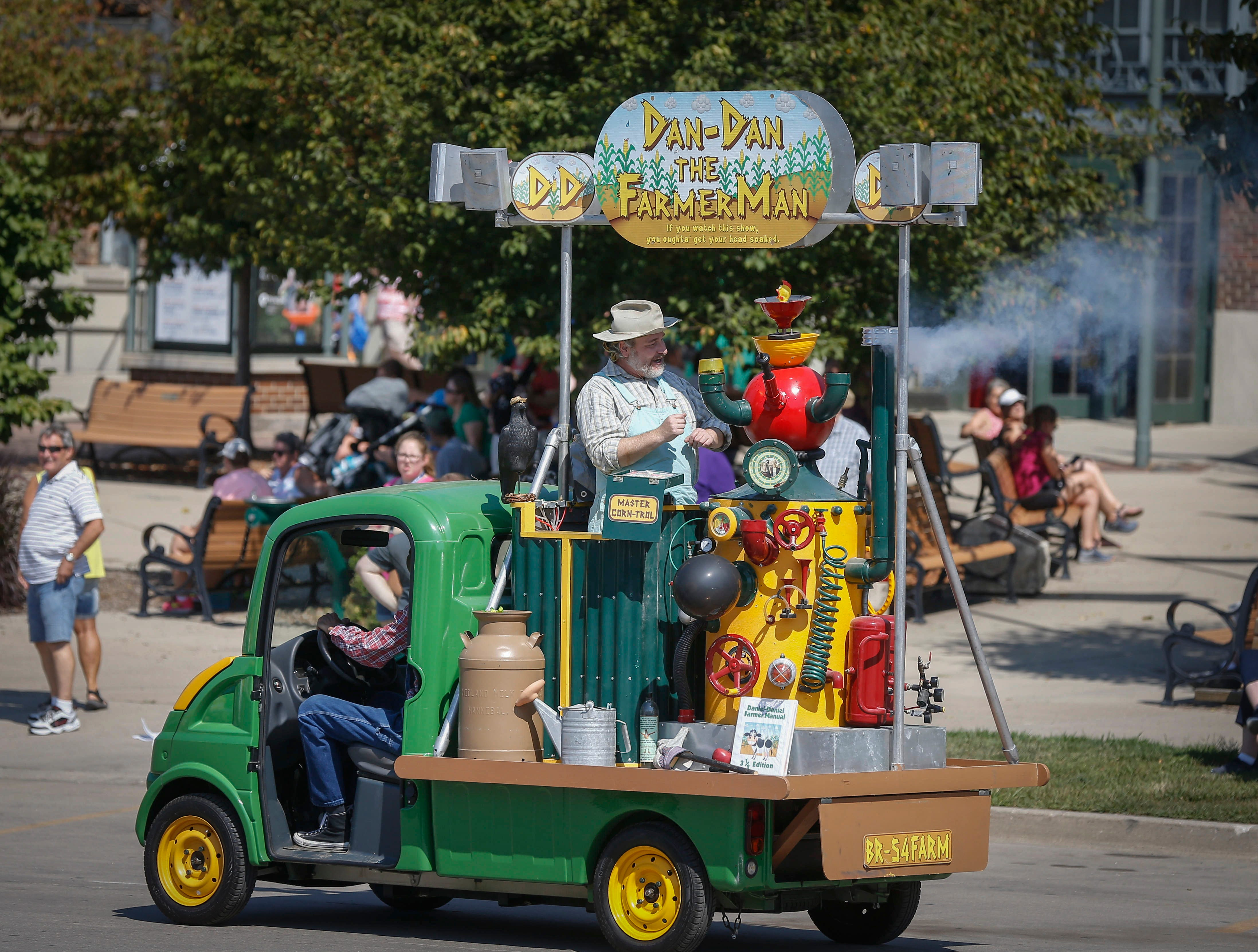 Dan-Dan the Farmer Man operates his truck down the street during the Iowa State Fair in Des Moines.