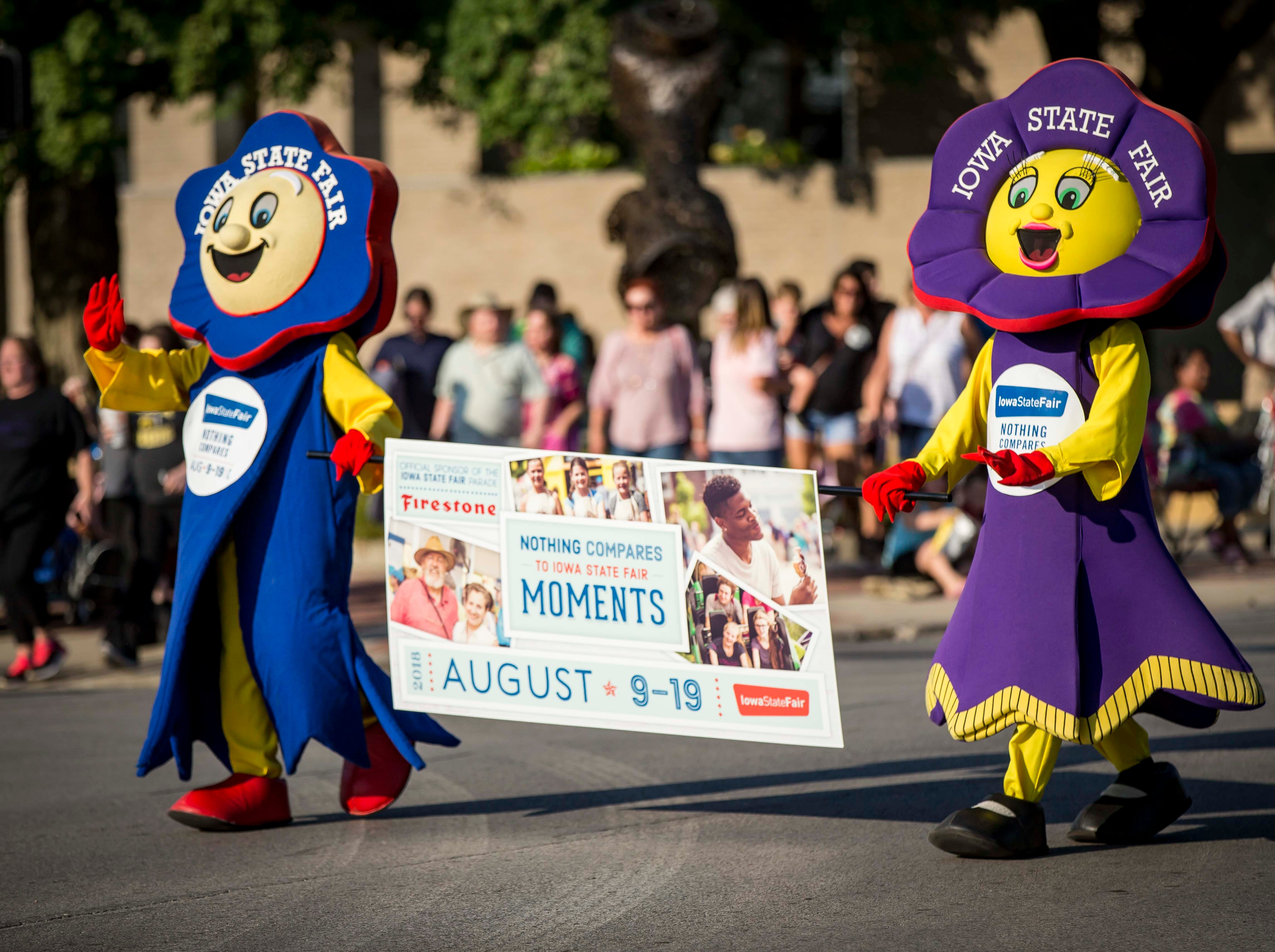 Blue Ribbon mascots Fairfield and Rosetta lead the 2018 Iowa State Fair parade from the Statehouse to downtown Des Moines Wednesday, Aug. 8, 2018. The Iowa State Fair runs from Aug. 9Ð19.