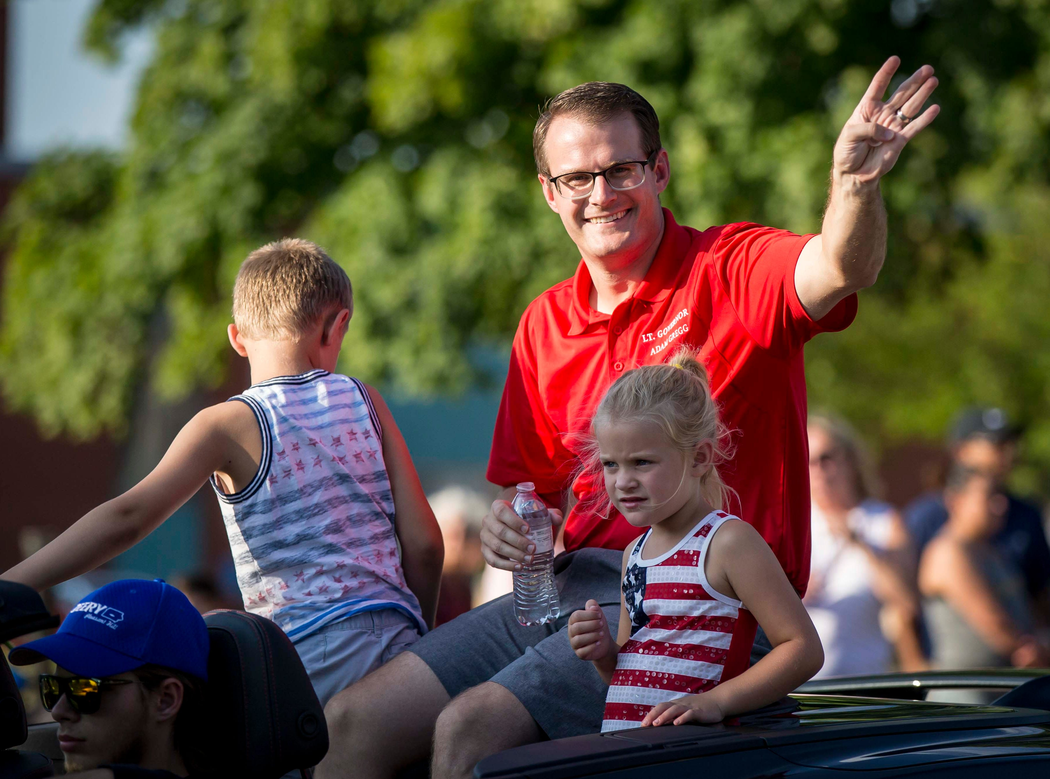 Acting Lt. Gov. of Iowa Adam Gregg and family ride in the 2018 Iowa State Fair parade from the Statehouse to downtown Des Moines Wednesday, Aug. 8, 2018. The Iowa State Fair runs from Aug. 9Ð19.