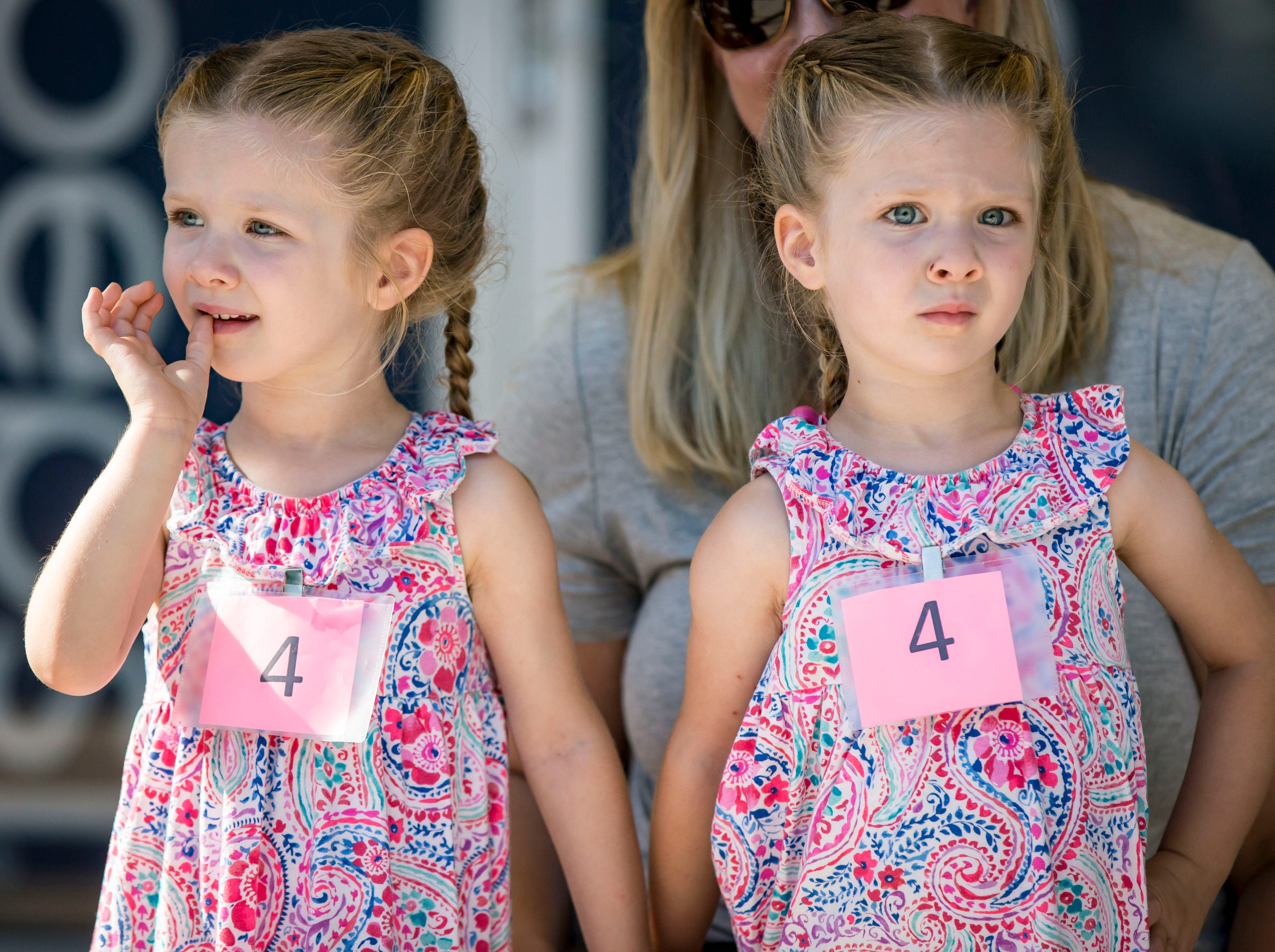 Brynn, left, and Anna Kundel of Granger compete in the three-year-old most alike category during the Twins, Triplets and More Contest on the Anne and Bill Riley Stage at the 2018 Iowa State Fair in Des Moines Thursday, Aug. 9, 2018.