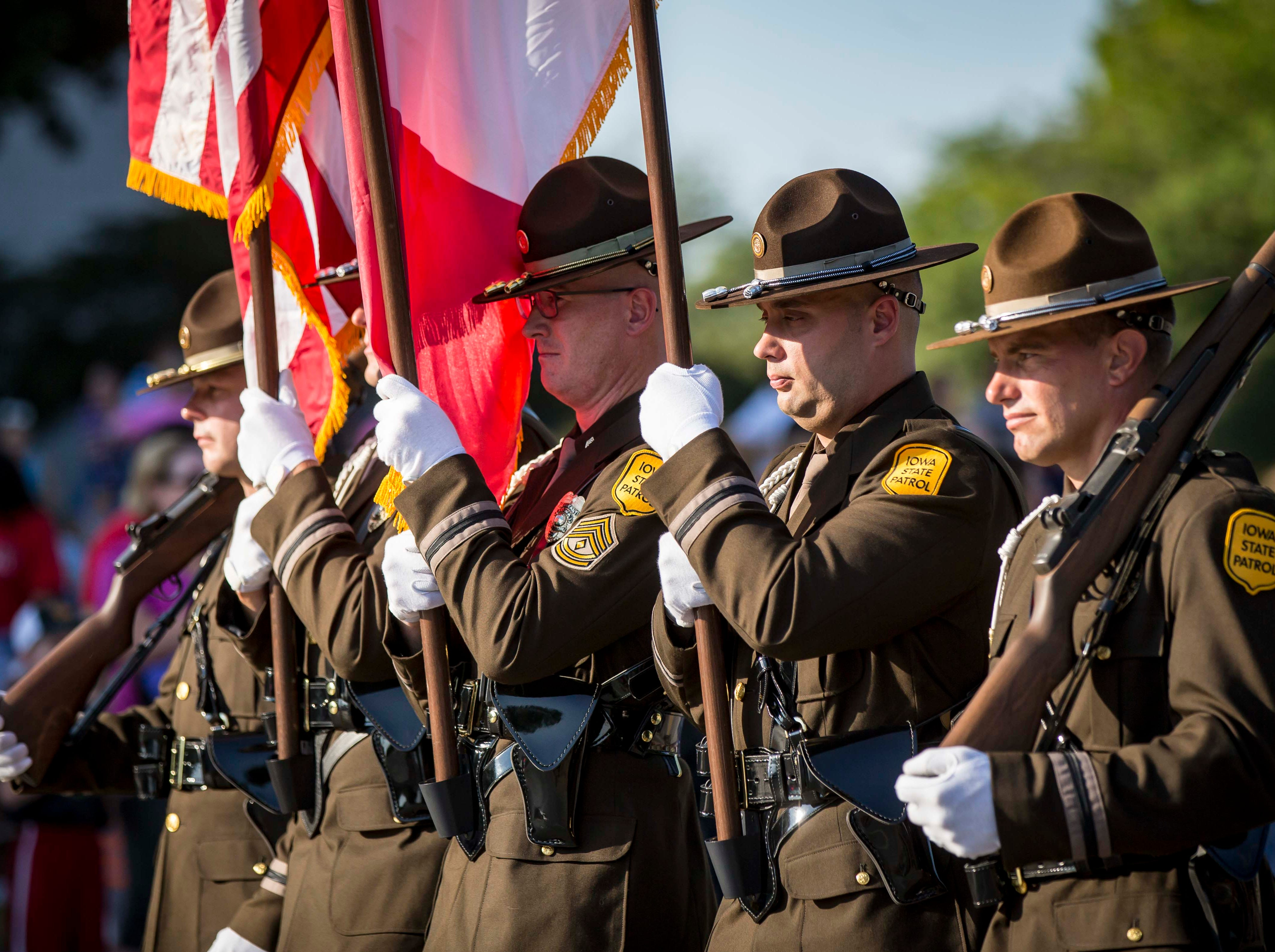An Iowa State Patrol color guard leads the 2018 Iowa State Fair parade from the Statehouse to downtown Des Moines Wednesday, Aug. 8, 2018. The Iowa State Fair runs from Aug. 9Ð19.