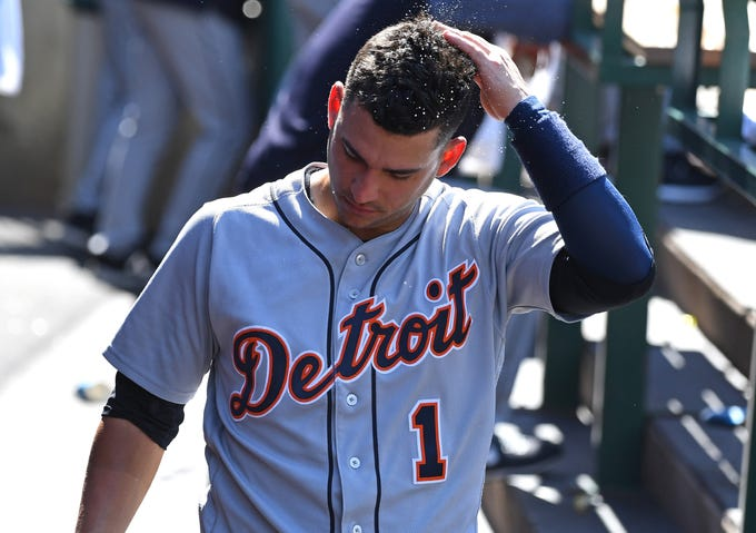 Detroit Tigers shortstop Jose Iglesias rubs his head in the dugout during the ninth inning against the Los Angeles Angels at Angel Stadium of Anaheim on Aug. 8, 2018.