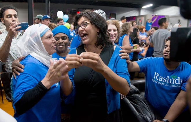 Rashida Tlaib, center, greets supporters and family at her election night party in northwest Detroit on Aug. 7, 2018.