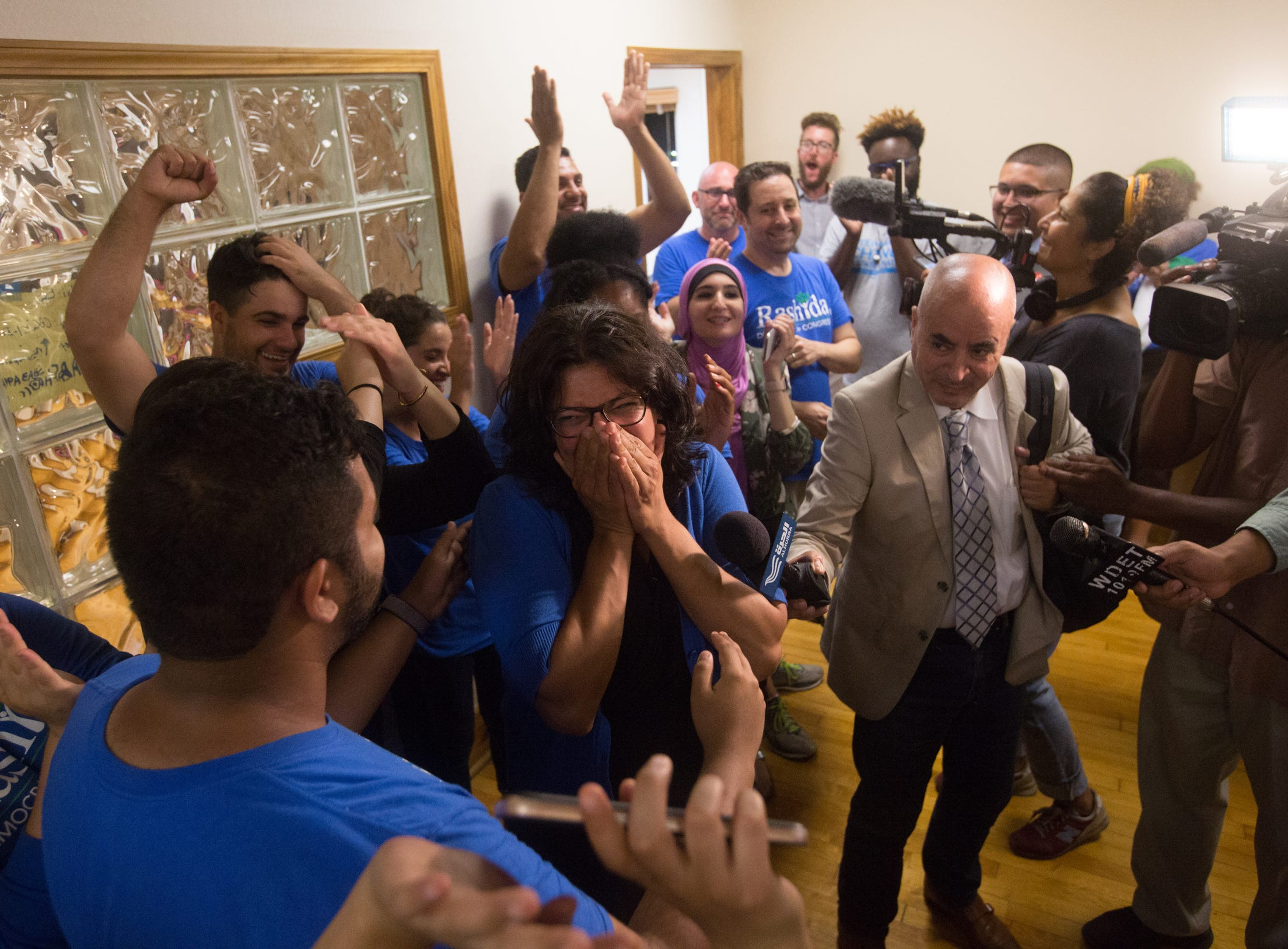 Rashida Tlaib celebrates after winning the Democratic Primary in Michigan's 13th District at one of Tlaib's field offices in Northwest Detroit on Aug. 7, 2018.