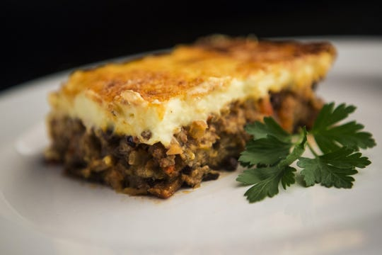 Moussaka, a layered dish of lamb, eggplants, and potatoes topped with a bechamel sauce, is photographed in the Post-Dispatch studio Wednesday, June 27, 2018. (Ryan Michalesko/St. Louis Post-Dispatch/TNS)