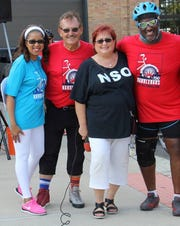 L-r, Sheilah Clay, NSO President & CEO;  Thomas E. Page, NSO board member; Denise Figurski, NSO Director;  David E. Rudolph, NSO Board Member