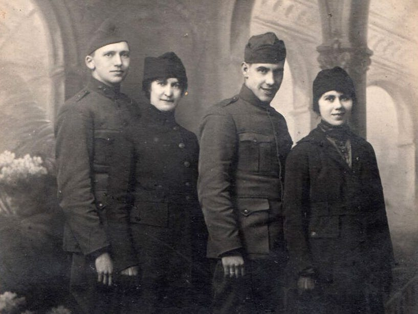 Marine City resident Oleda Joure, (far right)  stands with her brother Wallace Joure  behind her.  She worked as a telephone switchboard operator in France and he was also in the U.S. Army in this undated photo.
