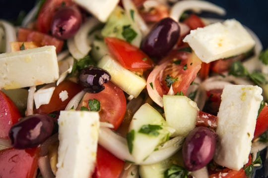 Horiatiki, a Greek salad of tomato, cucumber, onion, feta, parsley and olives tossed with a  vinagarette, is photographed in the Post-Dispatch studio Wednesday, June 27, 2018. (Ryan Michalesko/St. Louis Post-Dispatch/TNS)