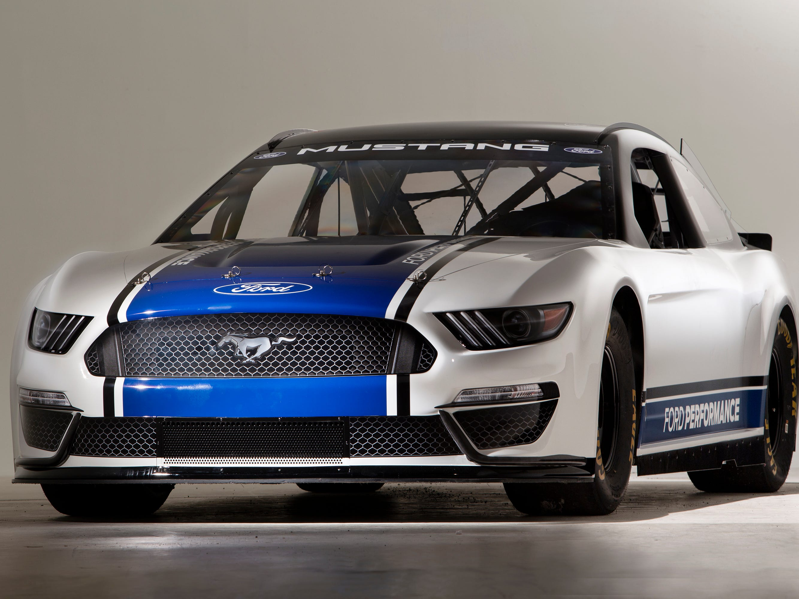 """Hau Thai-Tang, Ford's executive vice president, Product Development and Purchasing, was on hand to help unveil the car. He says, """"After more than a half-century, it feels great to finally let Mustang run in the top echelon of America's most popular stock car racing series."""""""