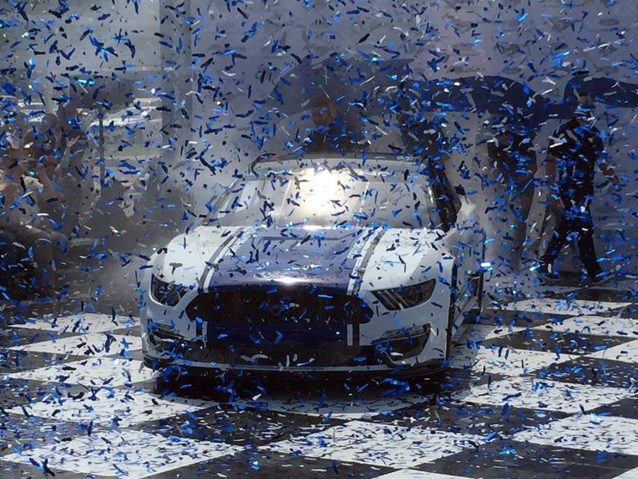 Driven by Tony Stewart, the new NASCAR Cup race Mustang blasts onto the stage at Ford World Headquarters in Dearborn, Mich. on Aug. 9, 2018.