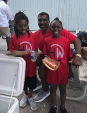 Horatio Williams with two students at Cedar Point.