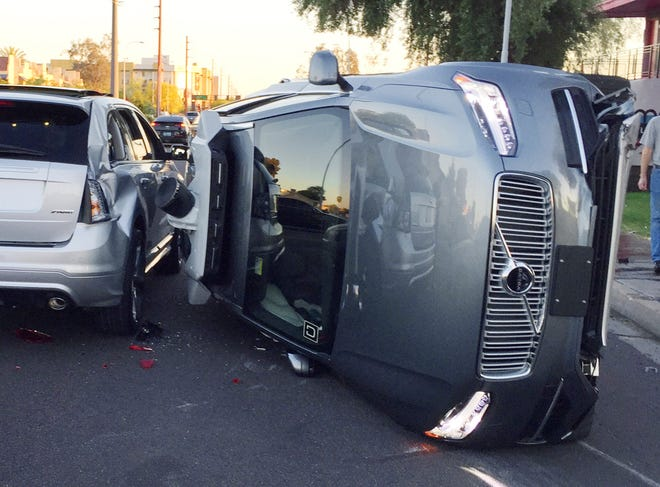 This March 24, 2017 photo, provided by the Tempe Police Department, shows an Uber self-driving SUV that flipped on its side in a collision in Tempe, Ariz. The crash serves as a stark reminder of the challenges surrounding autonomous vehicles in Arizona.