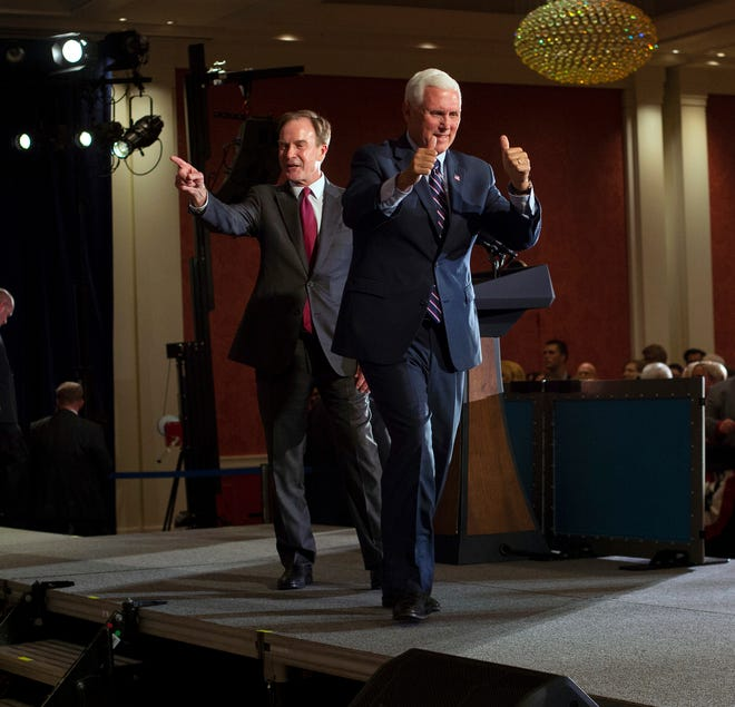 Republican gubernatorial candidate Bill Schuette and Vice President Mike Pence stand together after a GOP unity rally at the Amway Grand Plaza Hotel in Grand Rapids on Wednesday.