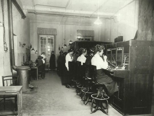 Hello Girls connect phone calls in the switchboard located in the Office of the Chief Signal Officer at the American Expeditionary Forces headquarters in Tours, France, Oct. 17, 1918.