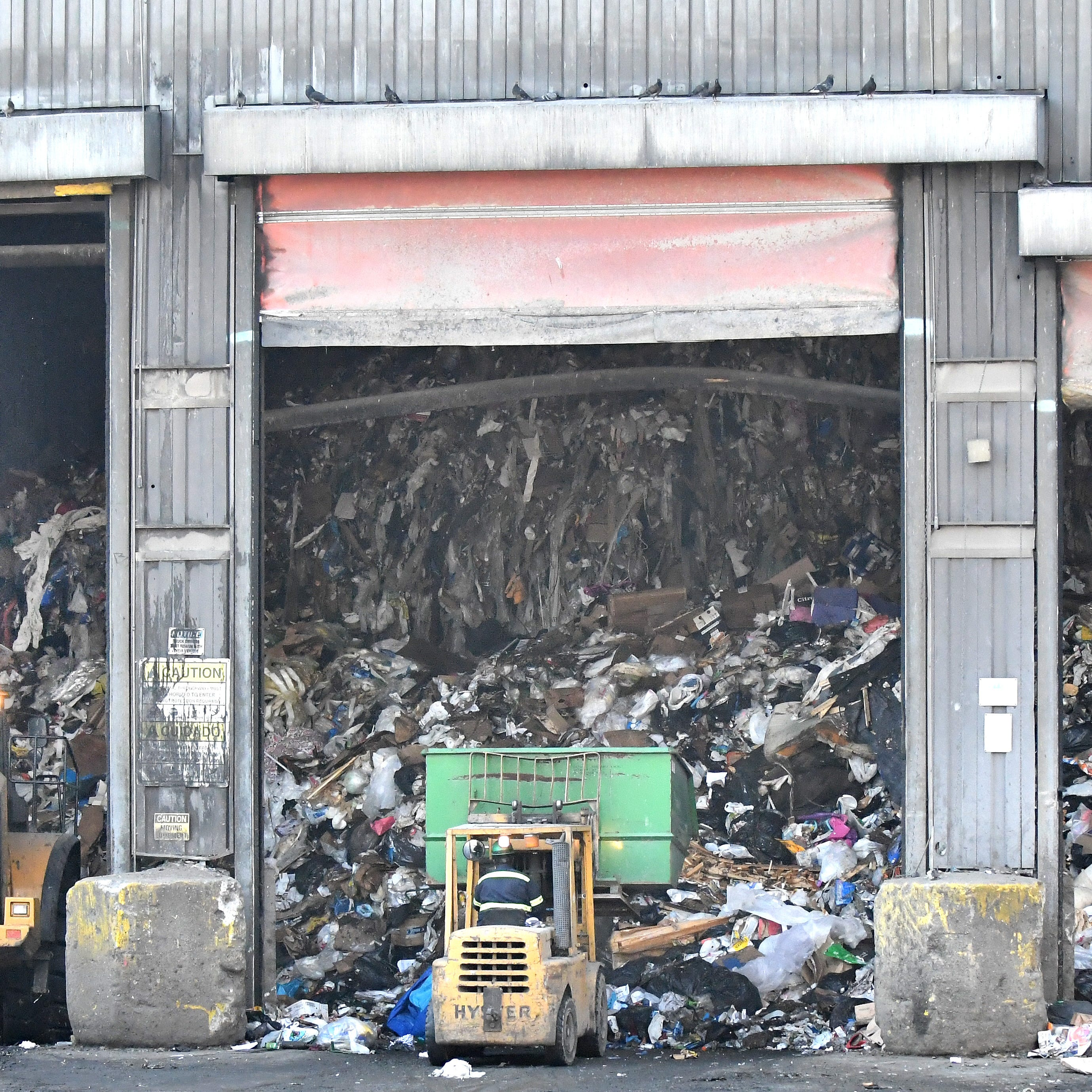 Waste is unloaded from trucks as it starts the process at Detroit Renewable Energy.