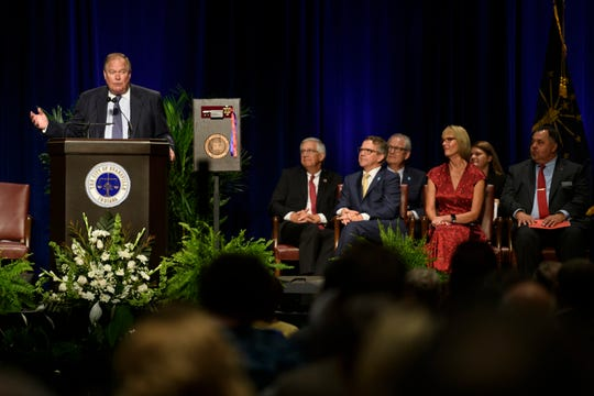 William Stone, left, addresses the crowd about the importance of giving back to his community during a dedication ceremony for the new Stone Family Center for Health Sciences in Downtown Evansville, Ind., Thursday, Aug. 9, 2018. Stone and his wife Mary Stone, both Evansville natives, made a $15 million gift to support the building of the health sciences center.