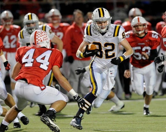 Castle senior wide receiver Cameron Parus runs the football during the first half of their regional championship game against Center Grove Friday, Nov. 9, 2012, at Center Grove High School in Greenwood, Indiana. Scott Roberson / Daily Journal