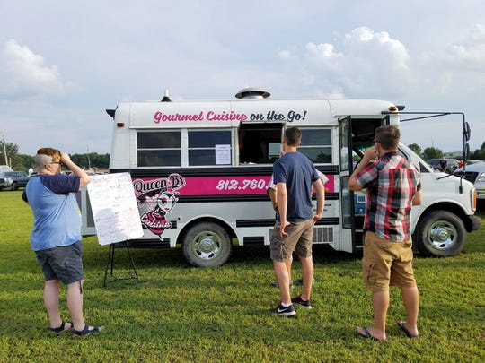Diners await their orders from Queen B's Cuisine at the Farm 57 Food Trucks at the Farm event on Aug. 9, 2018.