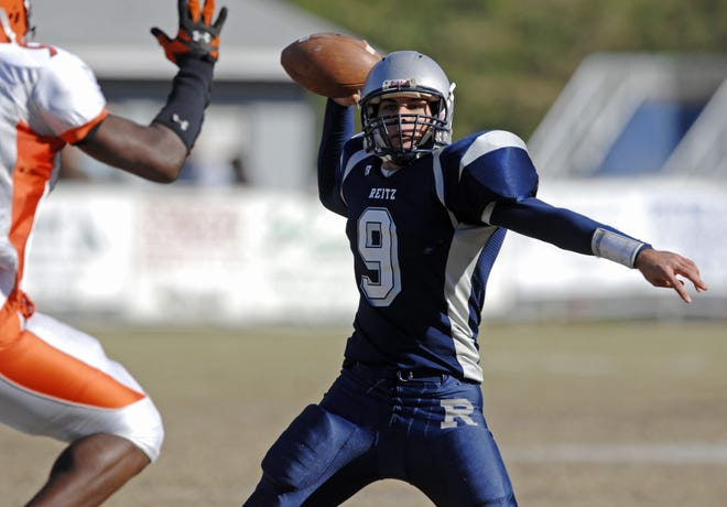 Paul McIntosh (9) was named Indiana's Mr. Football and won the state's Gatorade Player of the Year honor in lifting Reitz to the Class 4A state championship in 2007 and a 15-0 record.